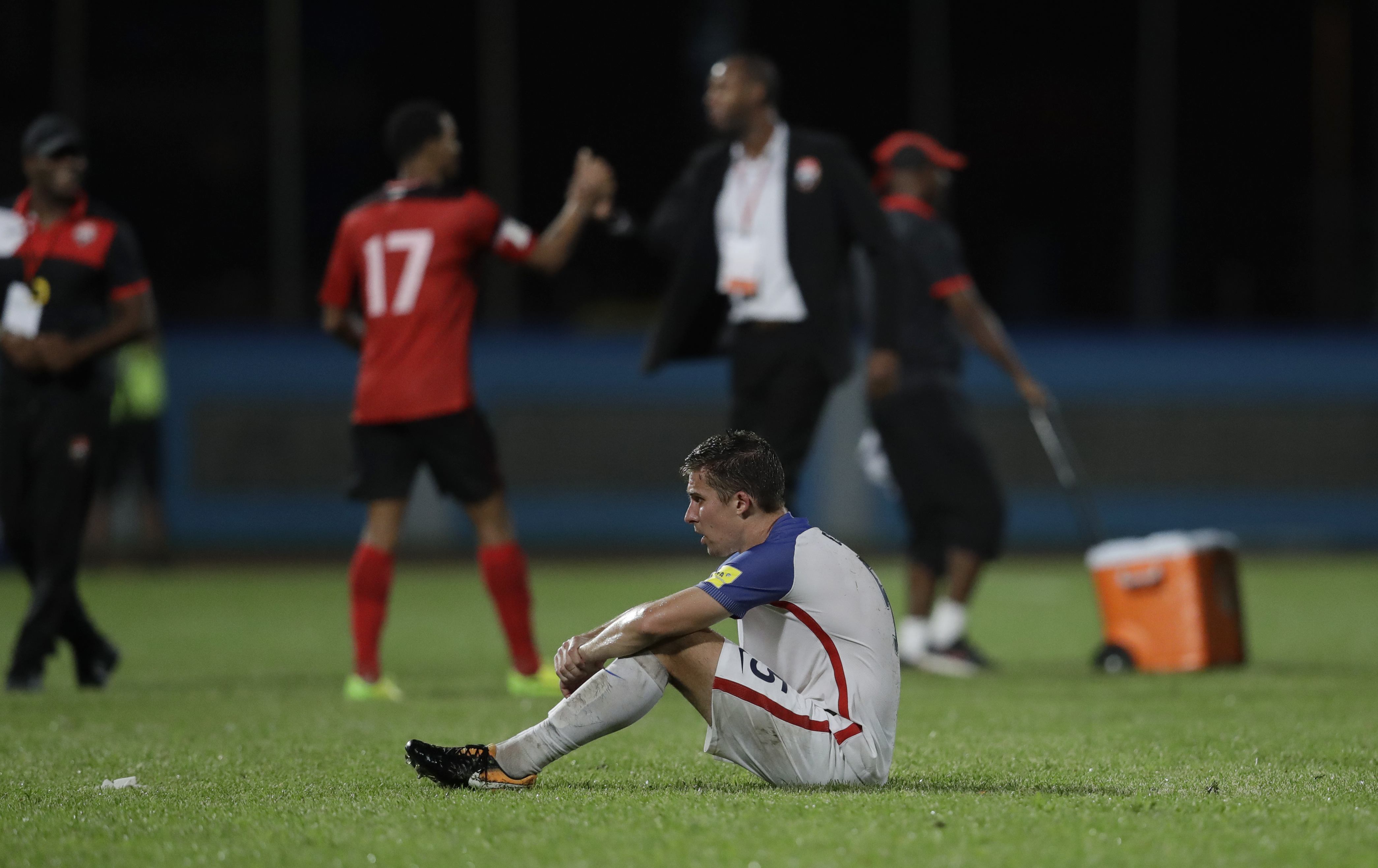USMNT's Matt Besler squats on the pitch after losing 2-1 against Trinidad and Tobago during a 2018 World Cup qualifying soccer match in Couva, Trinidad, on Oct. 10, 2017.