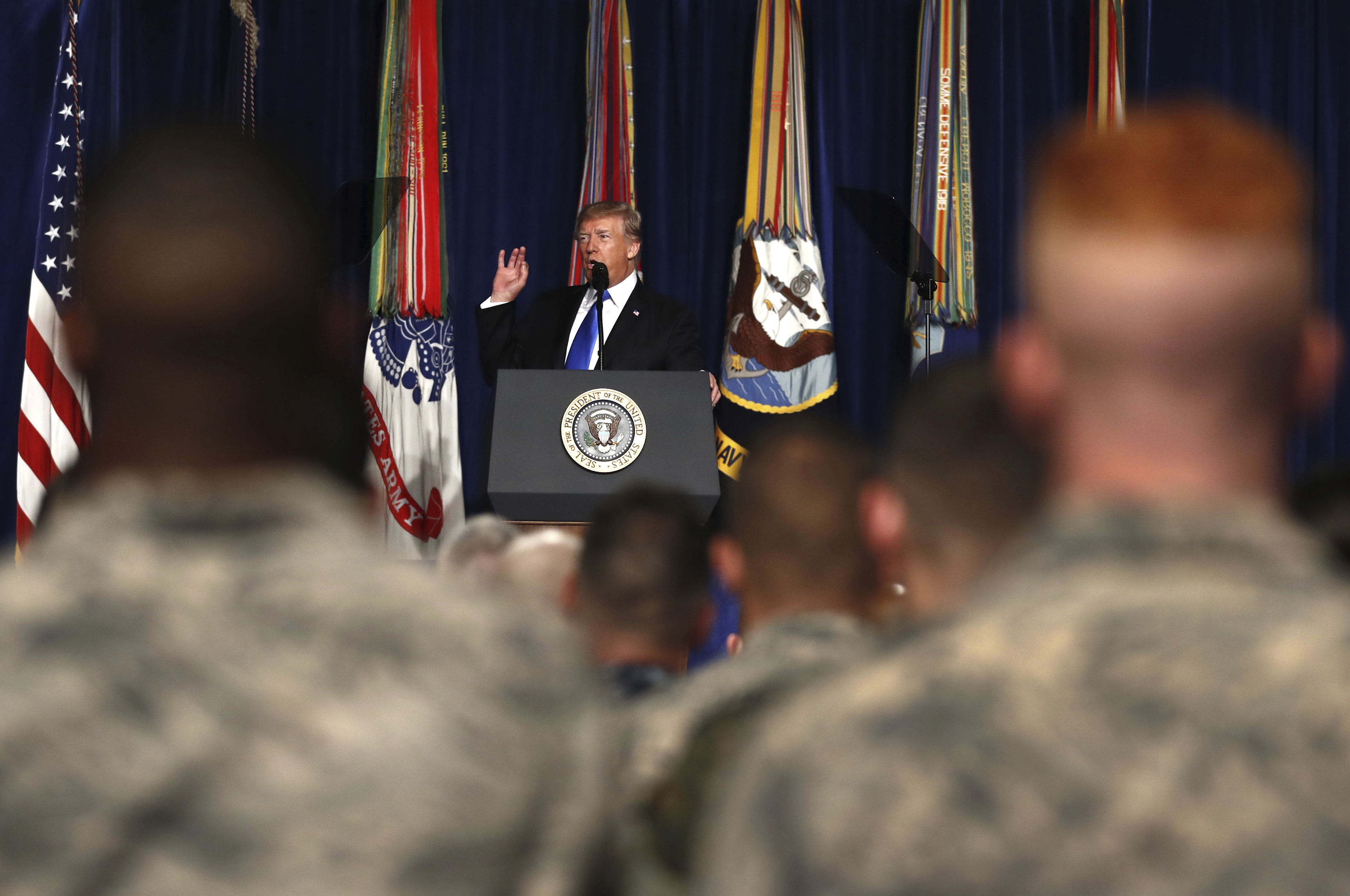 President Donald Trump speaks at Fort Myer in Arlington Va., about U.S. strategy in Afghanistan.