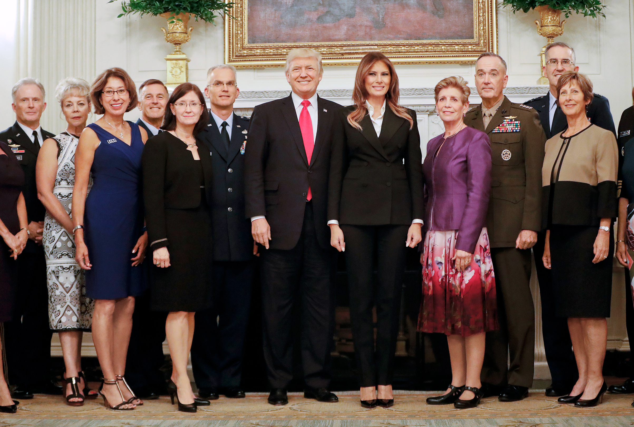 President Trump stands for a photo op after an Oct. 5 dinner with top U.S. military officials and their spouses