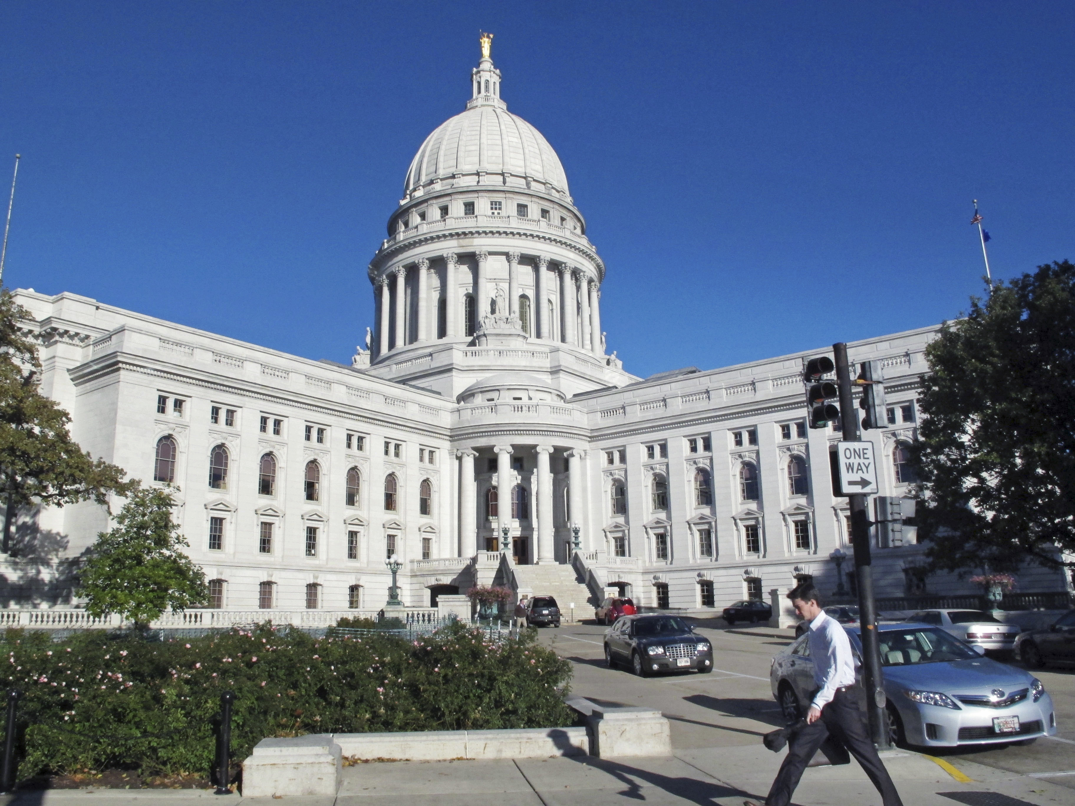 This Oct. 10, 2012, file photo shows a man walking by the Wisconsin state Capitol in Madison.