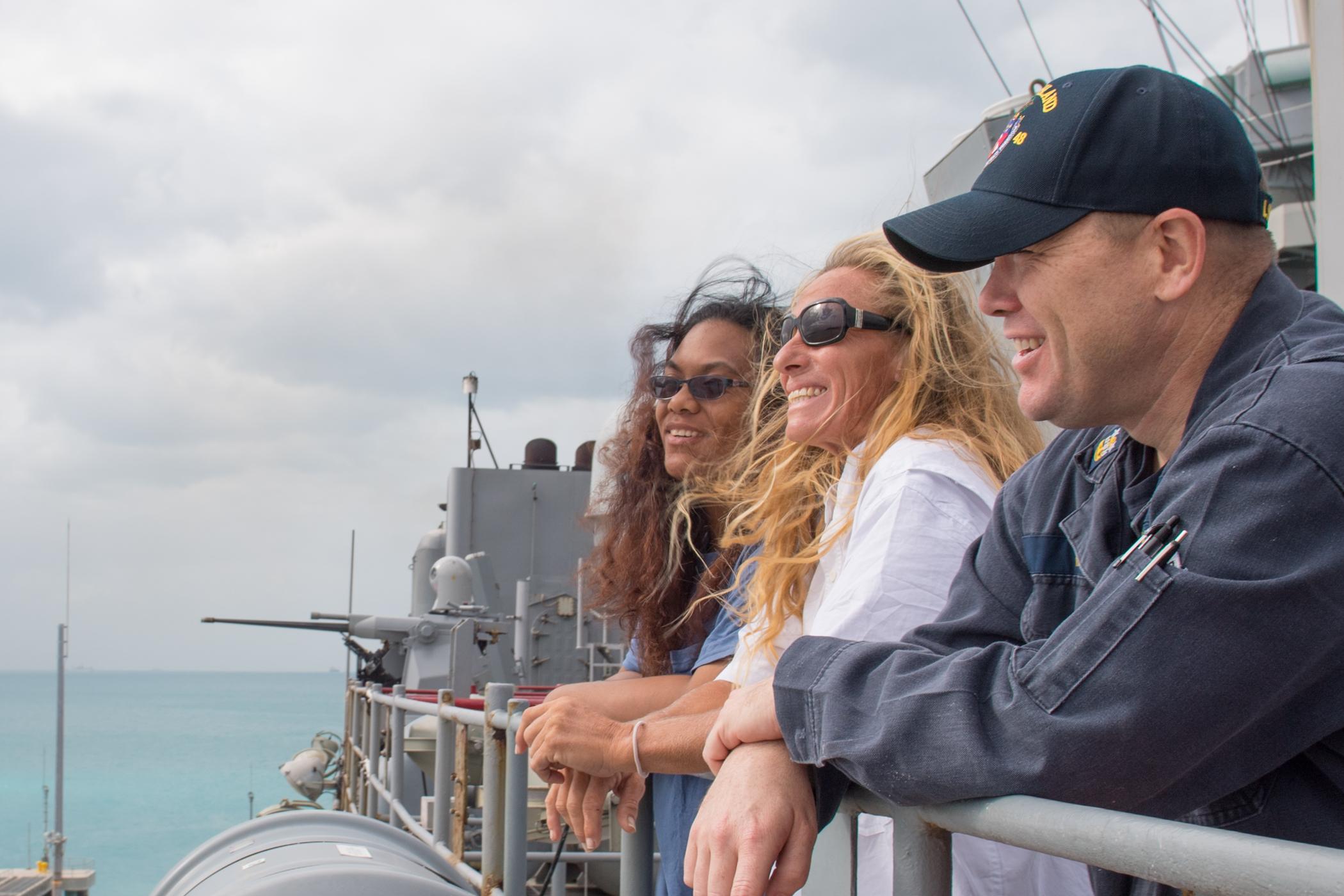 OKINAWA, Japan (Oct. 30, 2017) Natasha Fuiava, left, and Jennifer Appel, center, the two American mariners rescued at sea