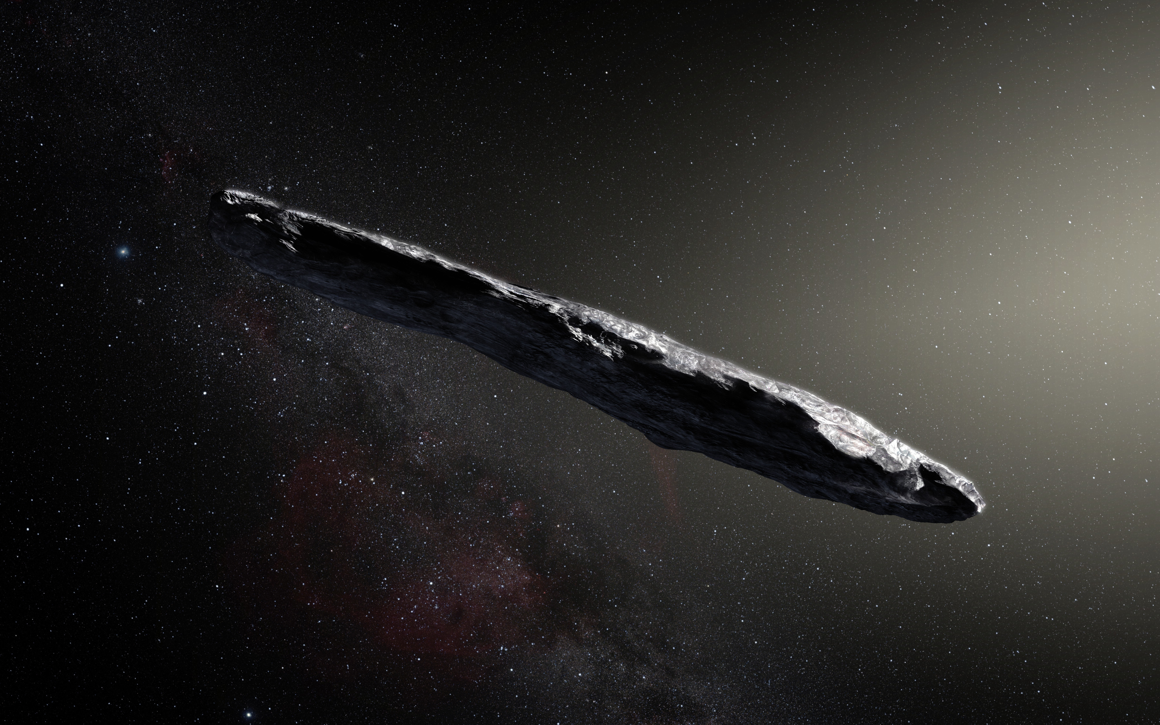This artist's impression shows the first interstellar asteroid: `Oumuamua. This unique object was discovered on 19 Oct. 2017 by the Pan-STARRS 1 telescope in Hawai`i.