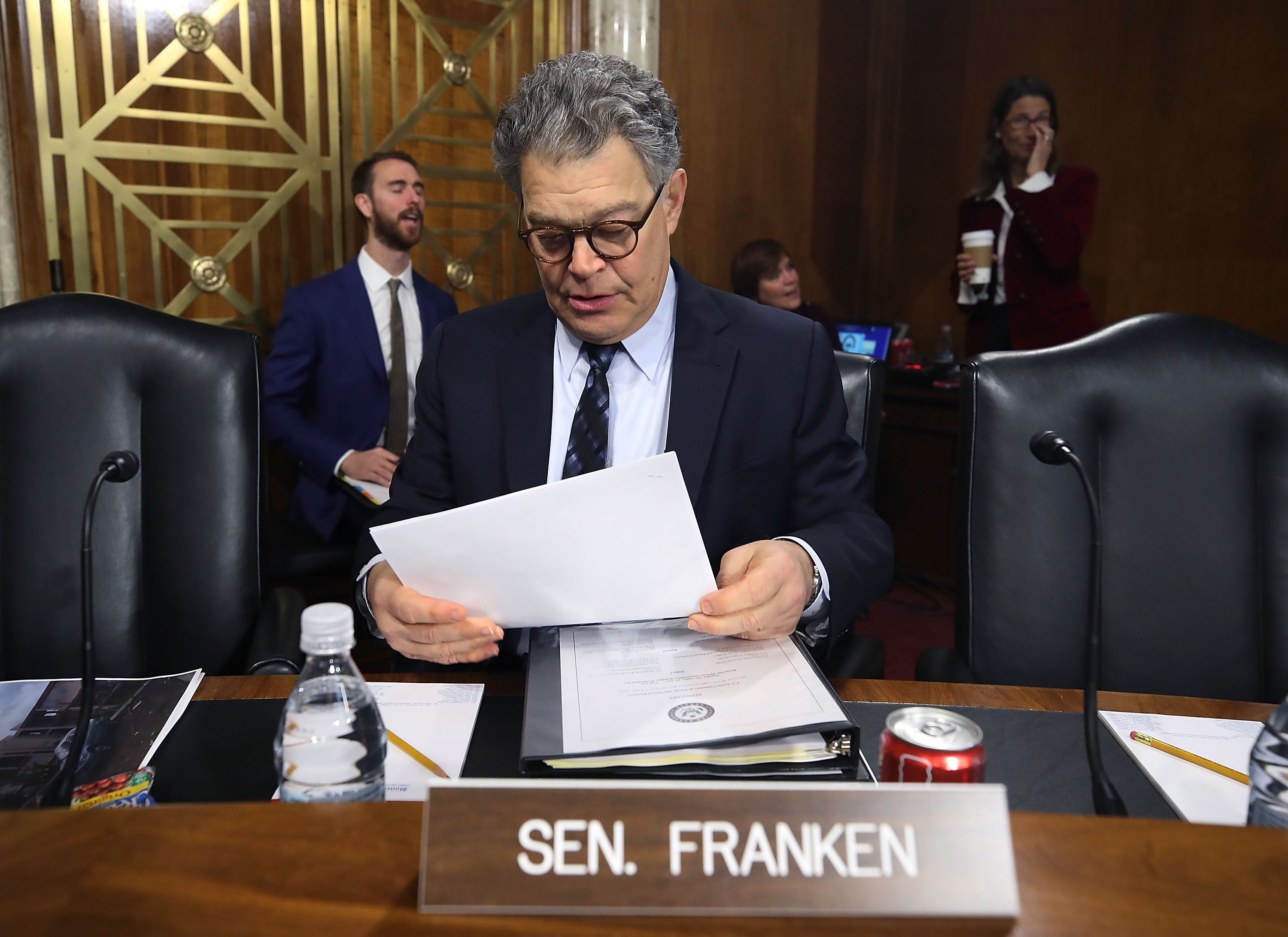 Sen. Al Franken looks over his papers during a Senate Energy and Natural Resources Committee hearing on November 14, 2017 in Washington, DC.