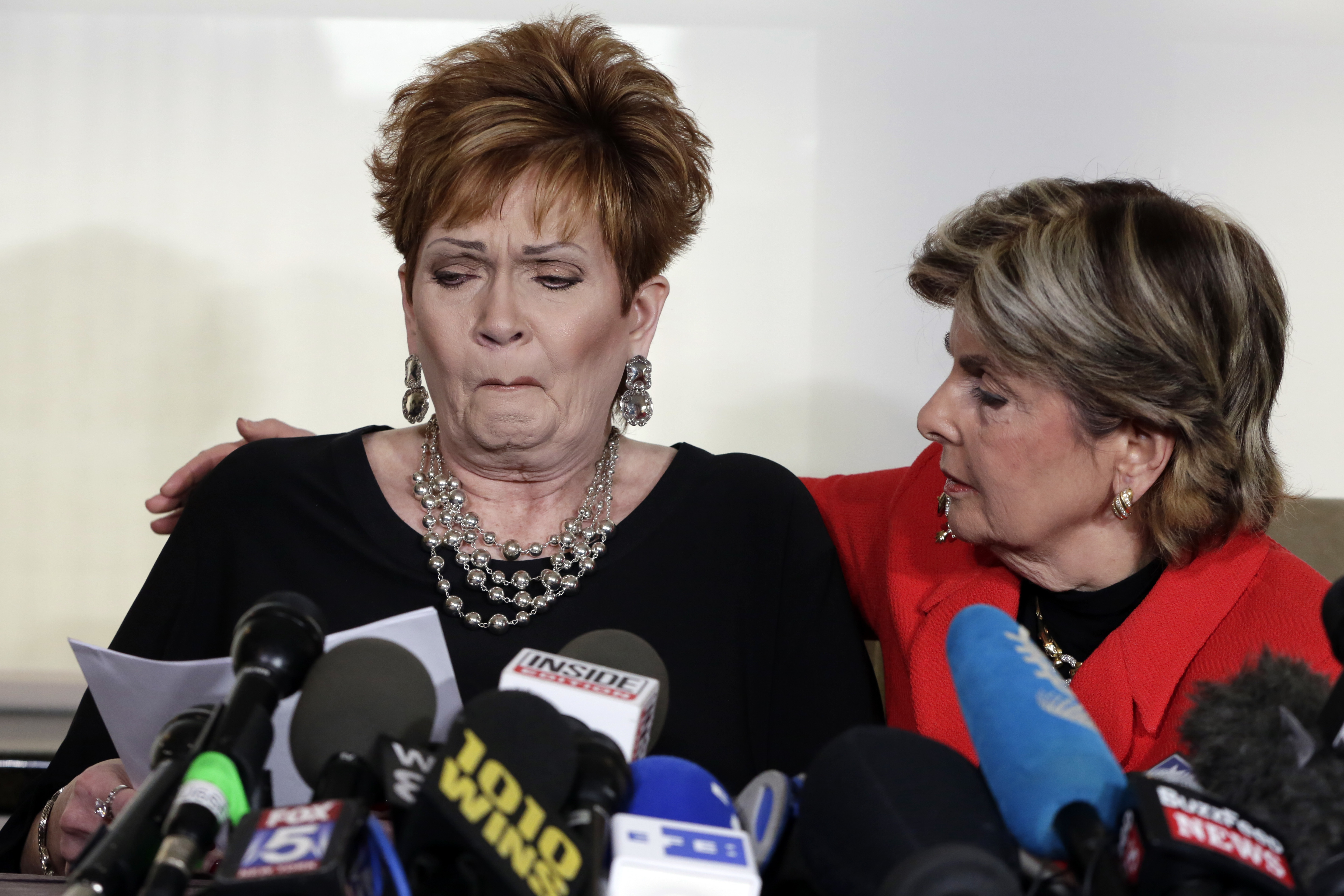 Beverly Young Nelson, left, the latest accuser of Alabama Republican Roy Moore, reads her statement as her attorney Gloria Allred looks on.