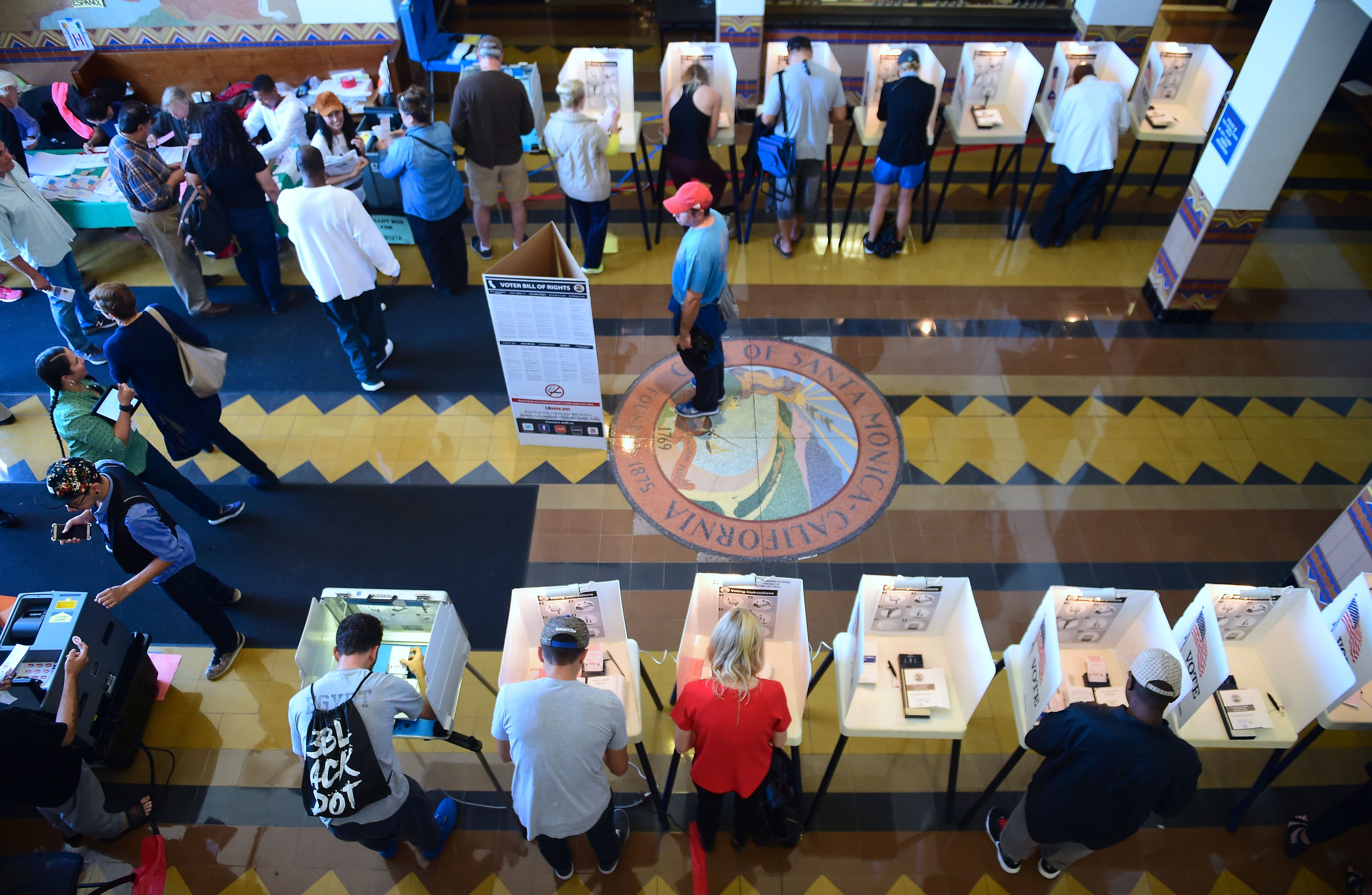 People vote on the US presidential election at Santa Monica City Hall on November 8, 2016 in Santa Monica, Calif.