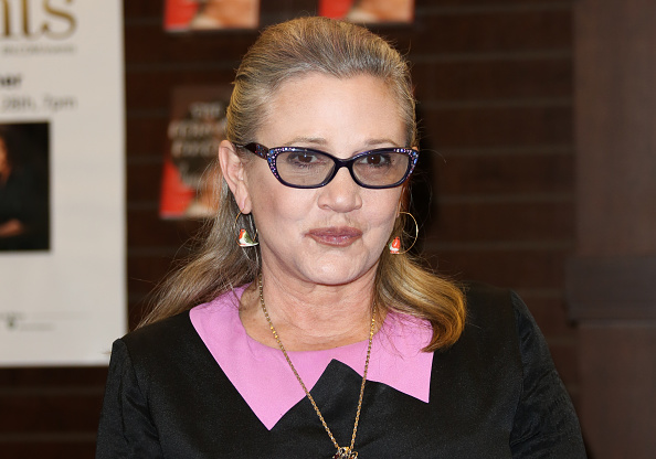 Carrie Fisher signs copies of her book 'The Princess Diarist' at Barnes & Noble at The Grove on Nov. 28, 2016 in Los Angeles, California.