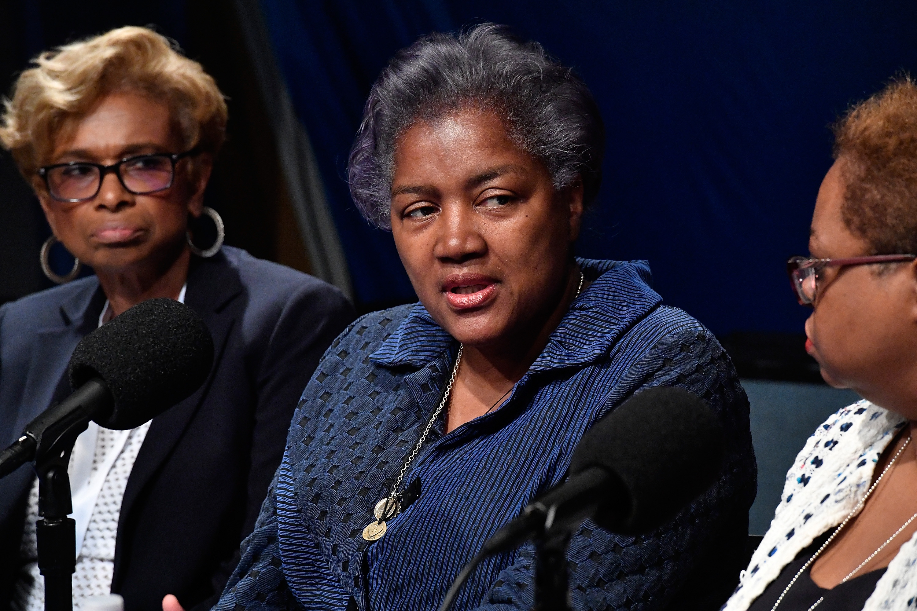 Donna Brazile, center, called Hillary Clinton's fundraising practices a  cancer  in an excerpt from her book, published online Thursday.