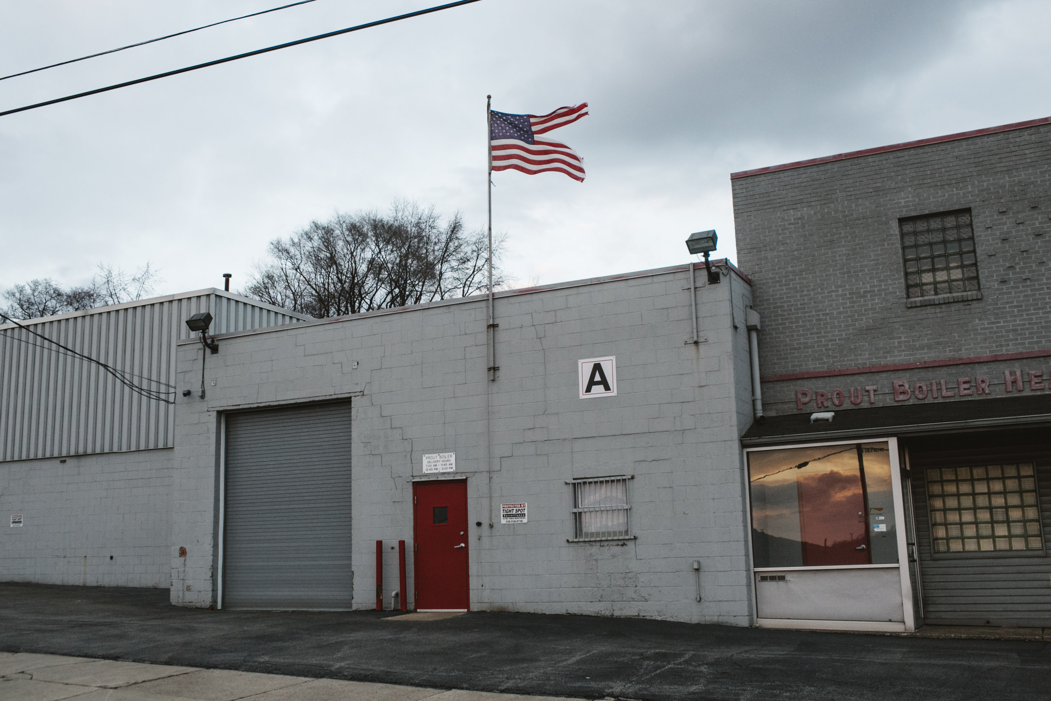 A tattered American flag flies over a heating business in Youngstown, Ohio on March 2, 2017.