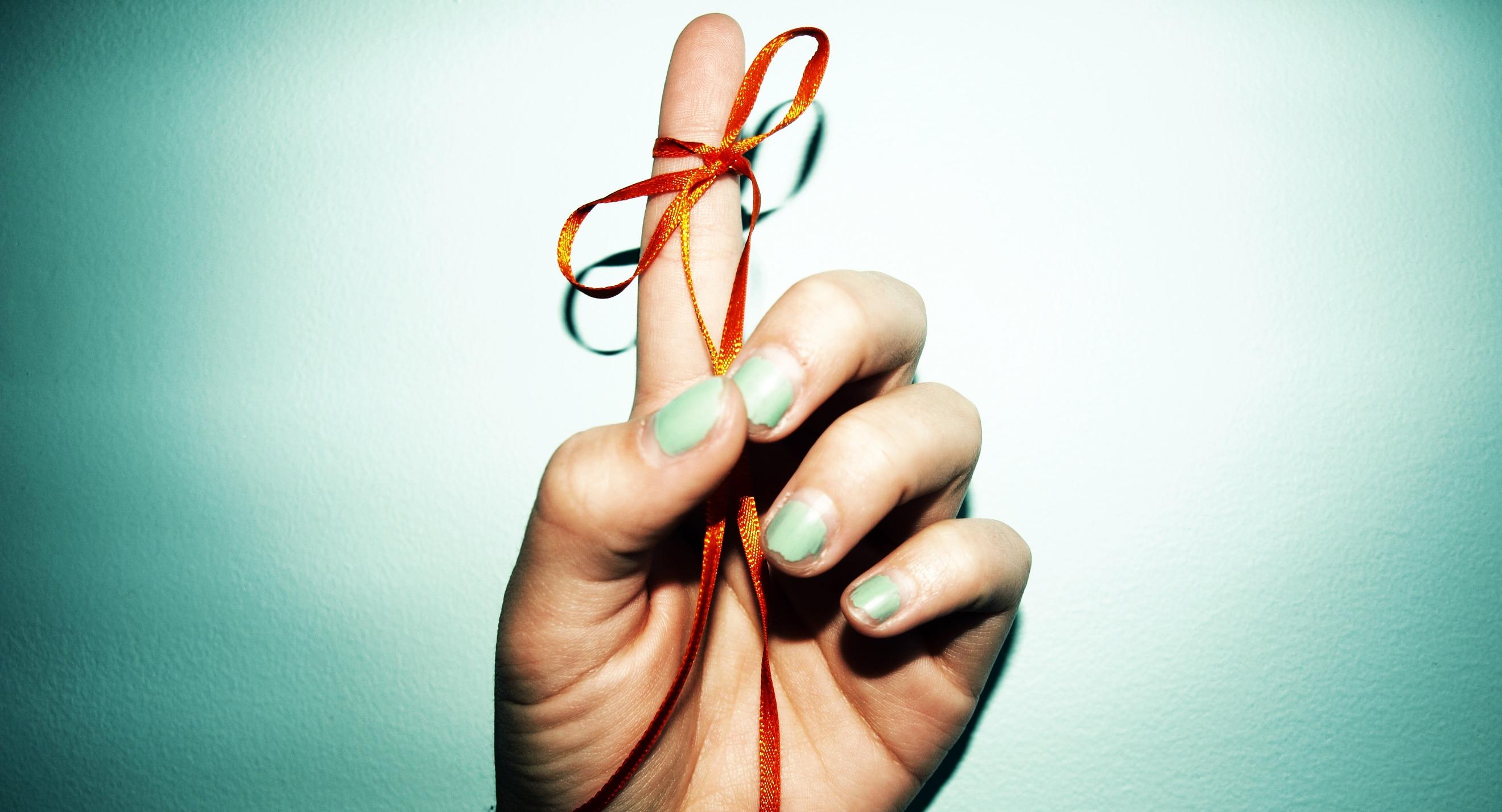 Reminder ribbon tied to finger.