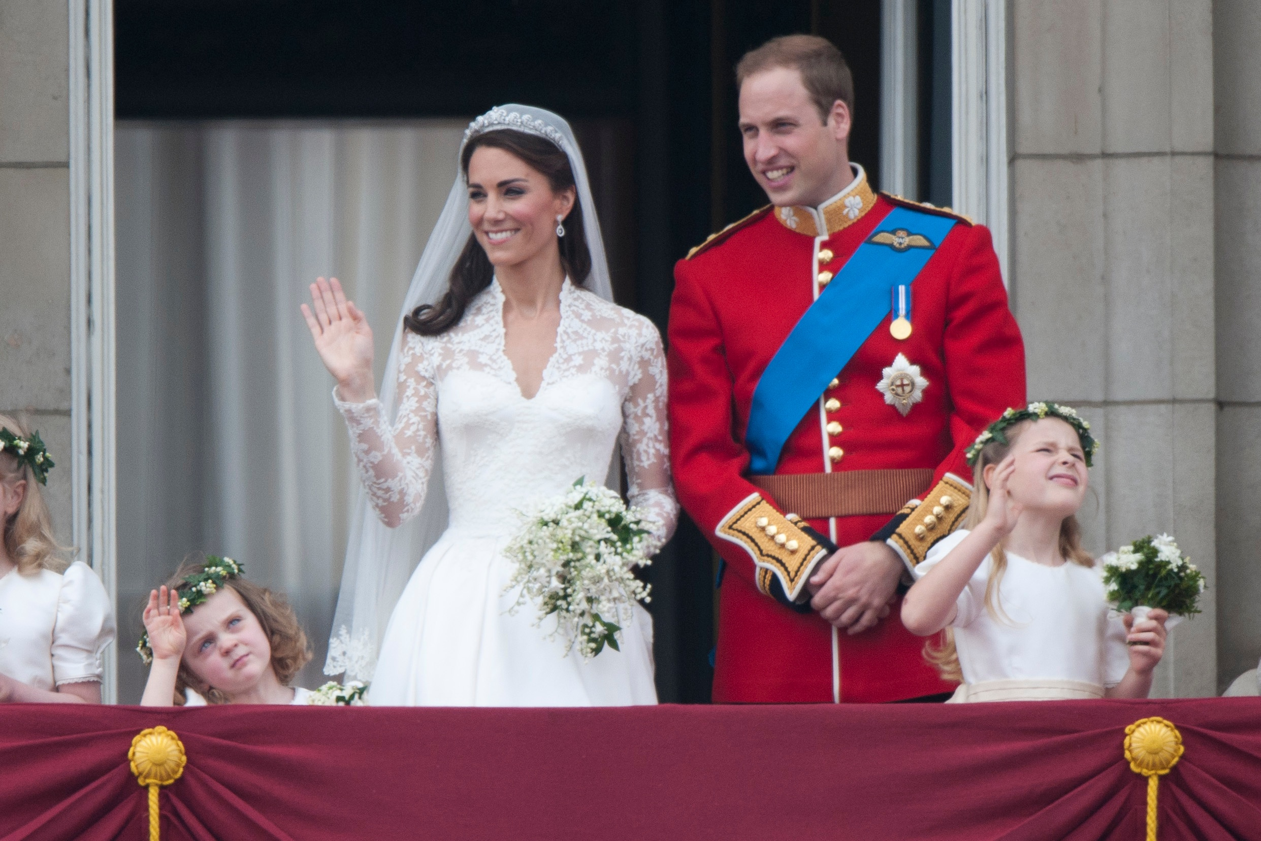 Catherine, Duchess of Cambridge and Prince William, Duke of Cambridge on the balcony at Buckingham Palace with Bridesmaids Margarita Armstrong-Jones (Right) And Grace Van Cutsem (Left), following their wedding at Westminster Abbey on April 29, 2011 in London, England.