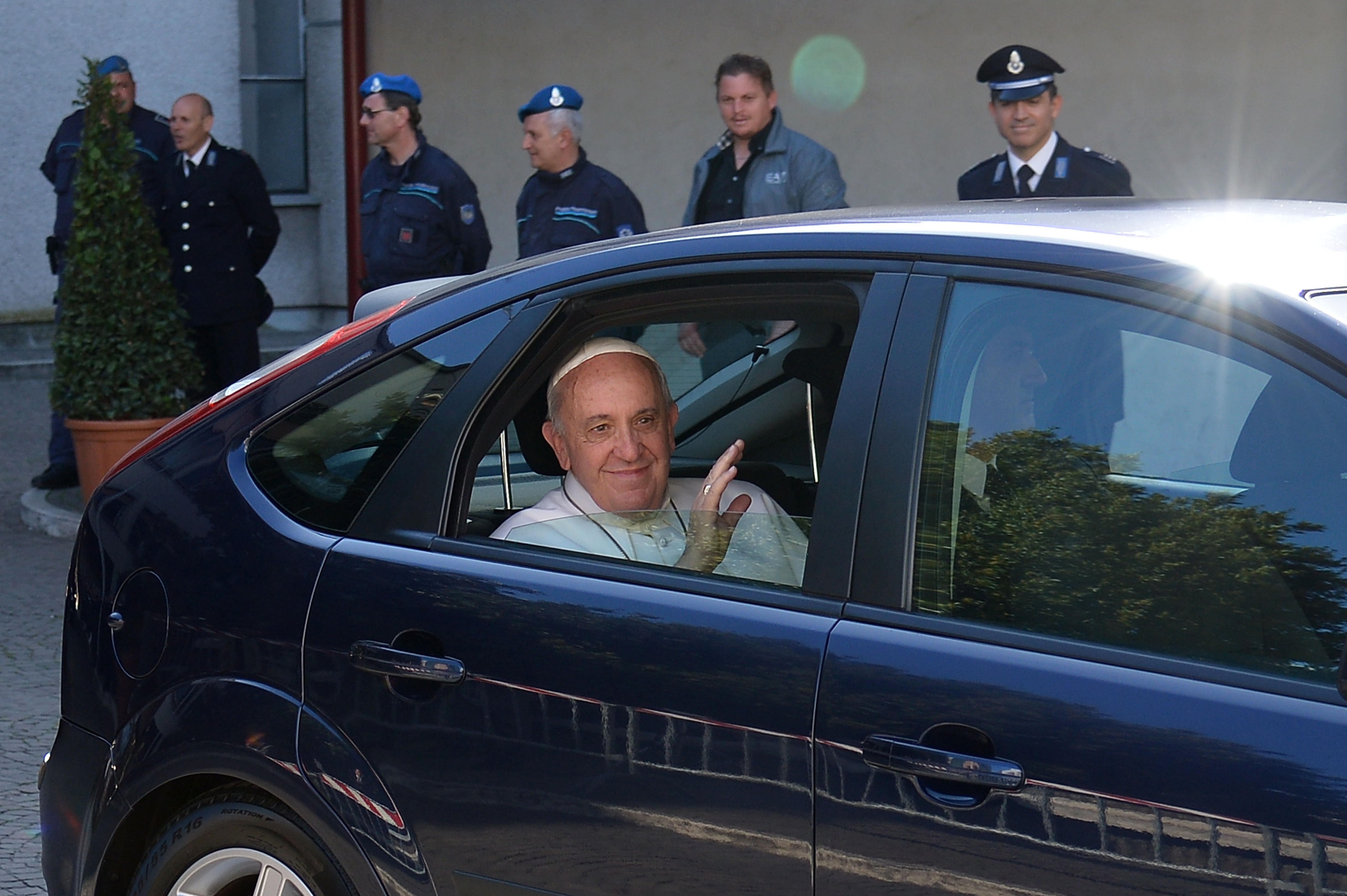 Pope Francis arrives by car at Rebibbia prison, where he washed the feet of prisoners in Rome, Italy on April 2, 2014.