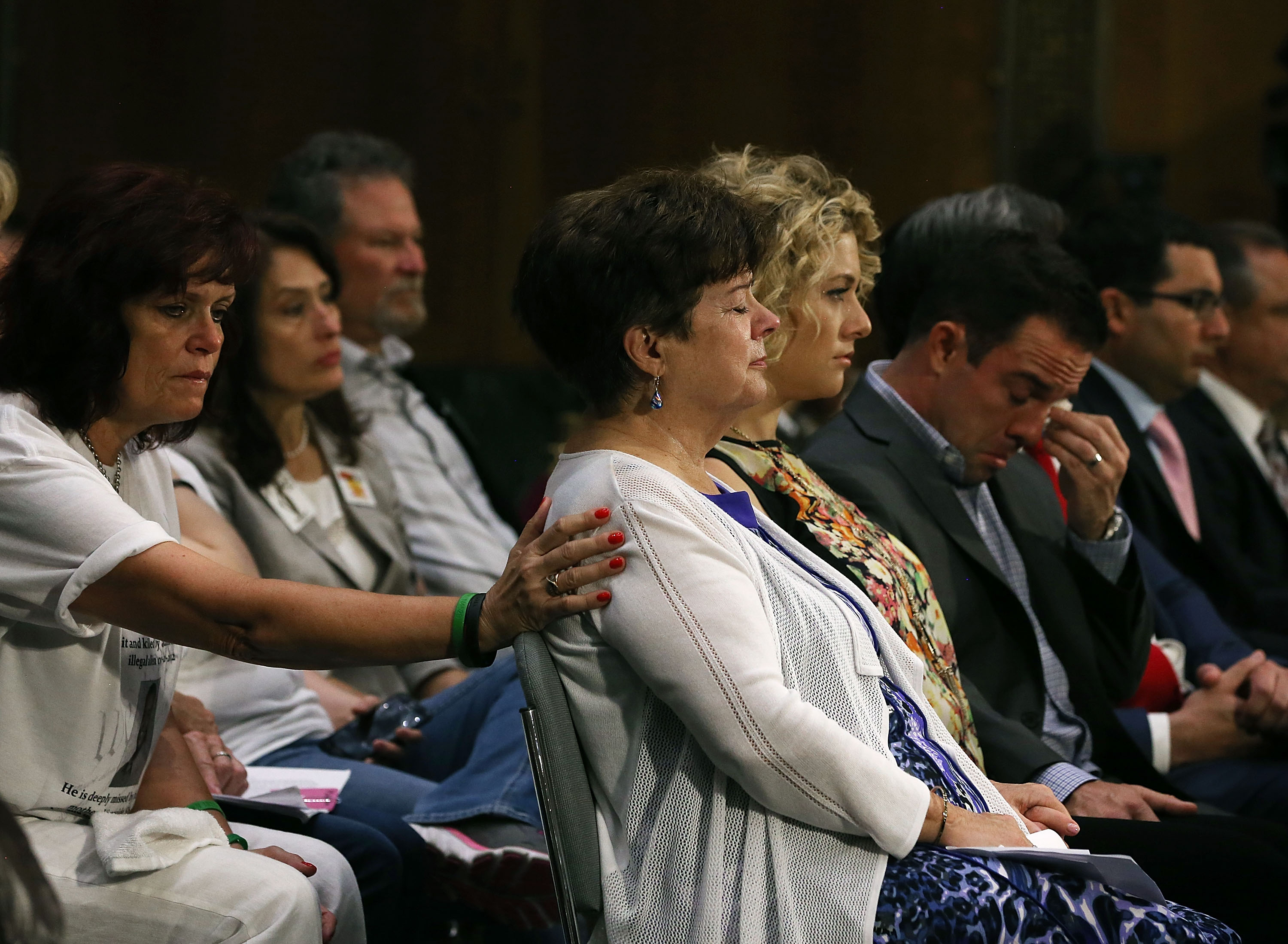 Liz Sullivan (C) mother of Kathryn  Kate  Steinle who was killed by an illegal immigrant in San Francisco, is comforted while her son Brad Steinle (R) sits nearby during a Senate Judiciary Committee hearing on Capitol Hill, July 21, 2015 in Washington, DC. The committee heard testimony from family members who have had loved ones killed by illegal immigrants.