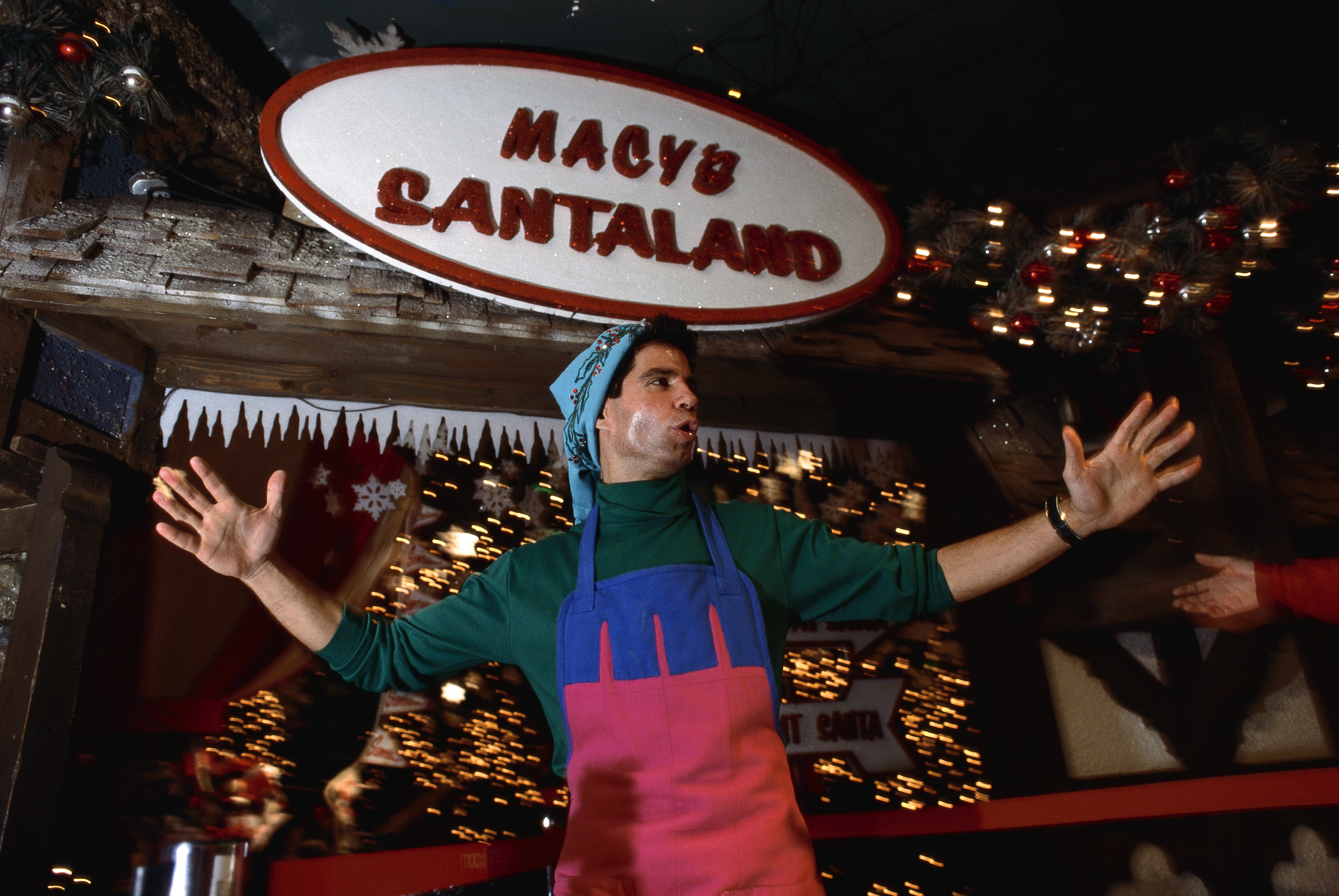 An  elf  in an apron and hat greets visitors to Macy's Santaland in the New York Macy's store during the Christmas season. (Photo by mark peterson/Corbis via Getty Images)