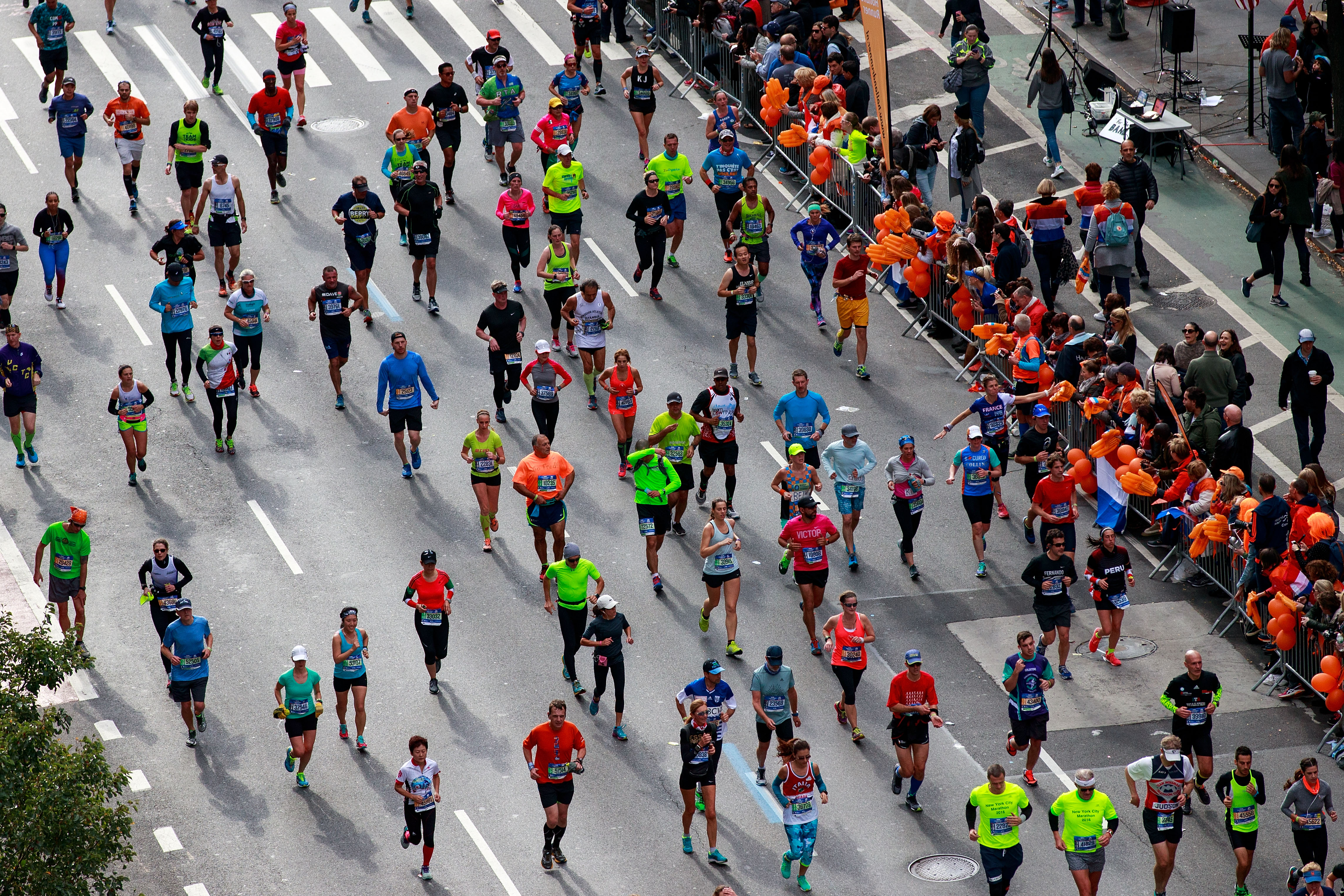 Runners make their way north on First Avenue during the 2016 TCS New York City Marathon, November 6, 2016 in New York City.