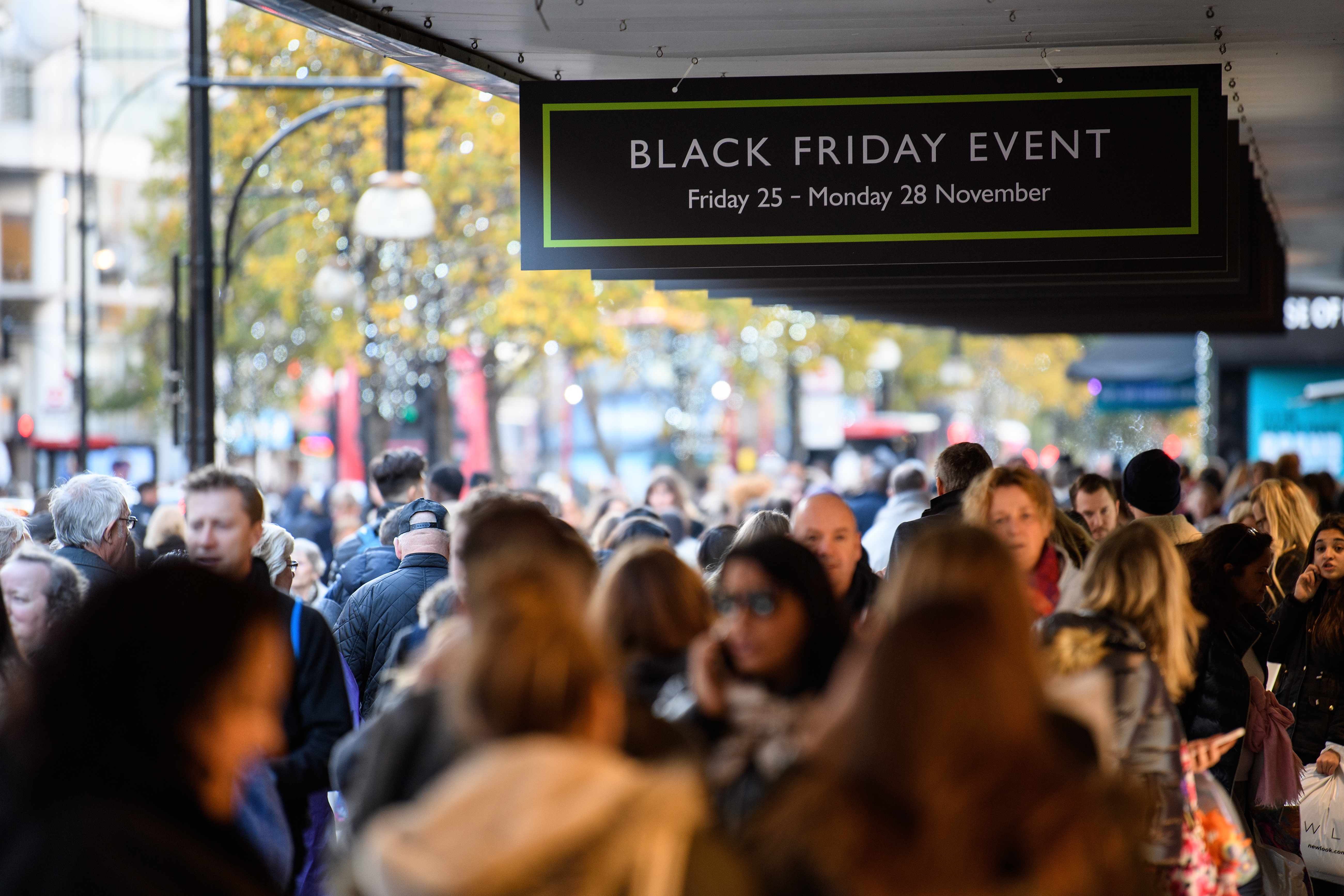 NOV. 25 2016 -  Shoppers carry their purchases on Oxford Street in London, England, as stores offer discounted items in their  Black Friday  sales