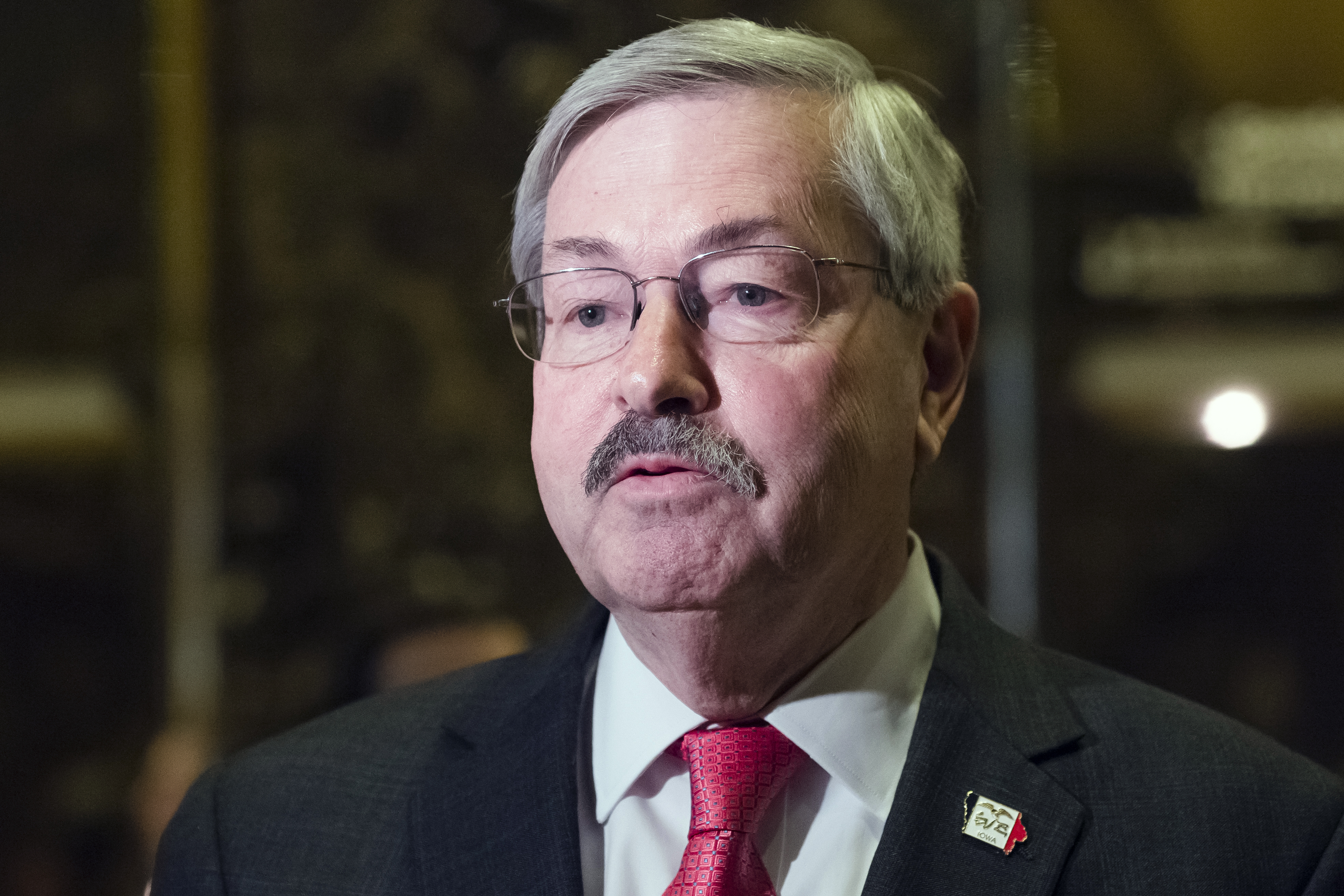 Terry Branstad, then governor of Iowa, speaks to members of the media in the lobby at Trump Tower in New York, U.S., on Tuesday, Dec. 6, 2016.