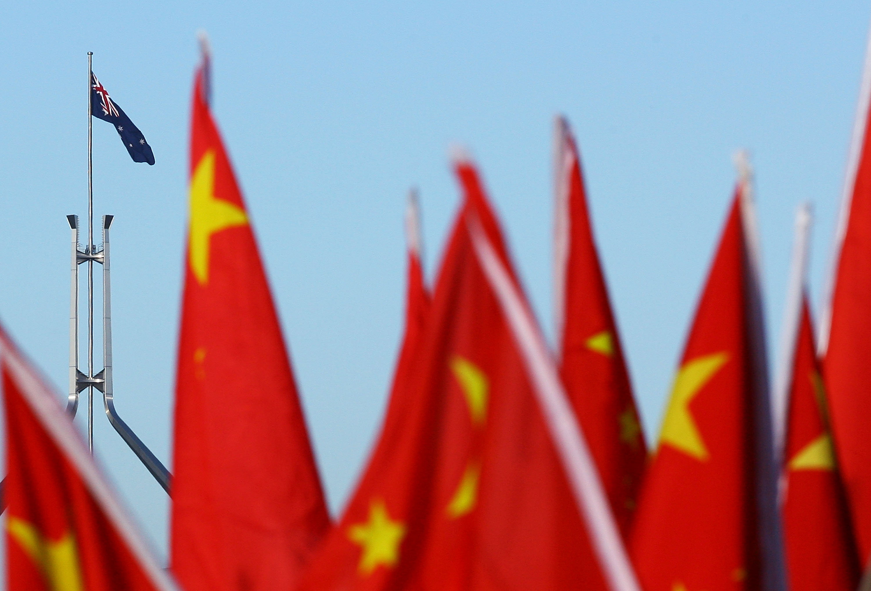 Chinese supporters hold flags at the start of the Olympic Torch relay at Reconciliation Place on April 24, 2008 in Canberra, Australia.
