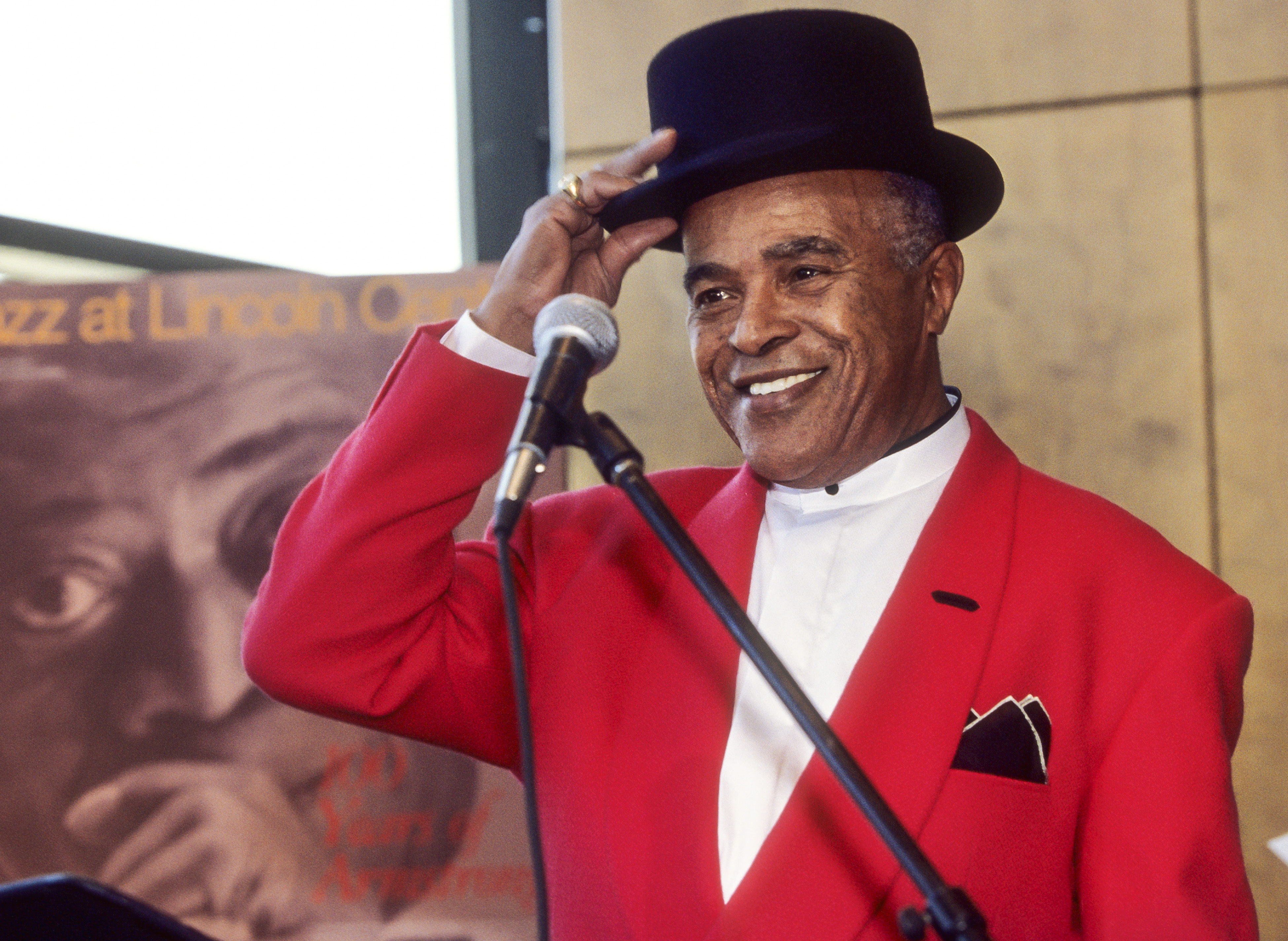 American Jazz musician Jon Hendricks tips his hat during a Jazz at Lincoln Center press conference on Feb. 1, 2000.