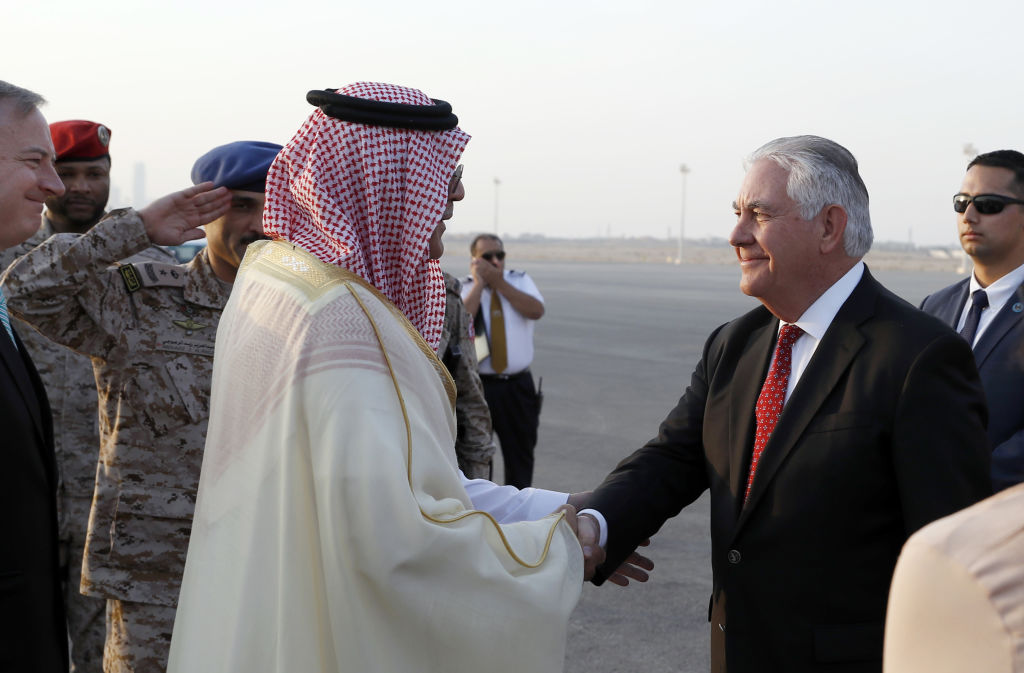 Secretary of State Rex Tillerson is greeted as he arrives at King Salman Air Base on October 21, 2017, in Riyadh, Saudi Arabia.                        US Secretary of State Rex Tillerson arrived in Saudi Arabia Saturday, his second visit to the region in recent months as he seeks a breakthrough in a diplomatic crisis gripping the Gulf. / AFP PHOTO / POOL / Alex Brandon        (Photo credit should read ALEX BRANDON/AFP/Getty Images)