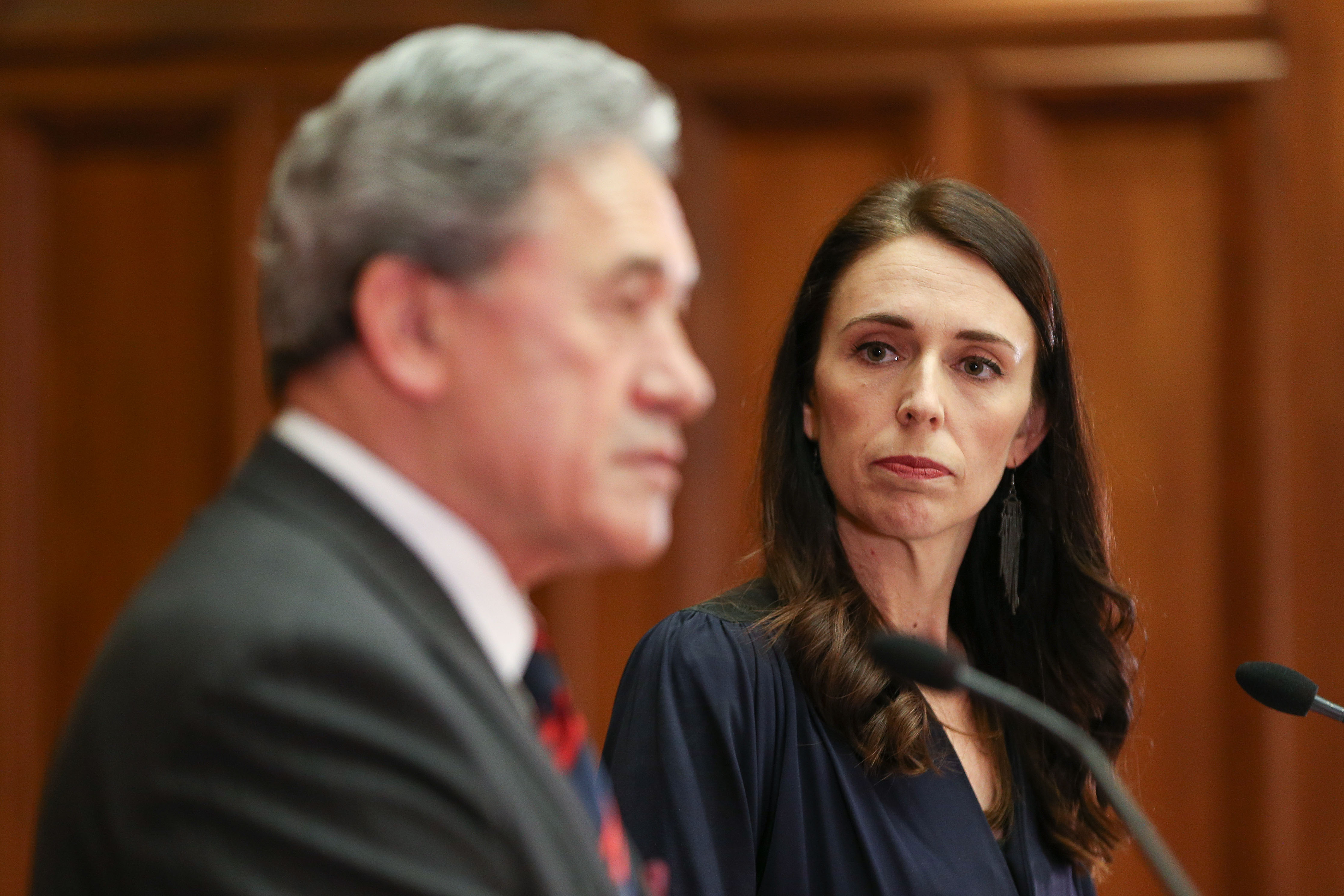 Then Prime Minister-designate Jacinda Ardern and New Zealand First leader Winston Peters speak to media during a coalition agreement signing at Parliament on October 24, 2017 in Wellington, New Zealand.