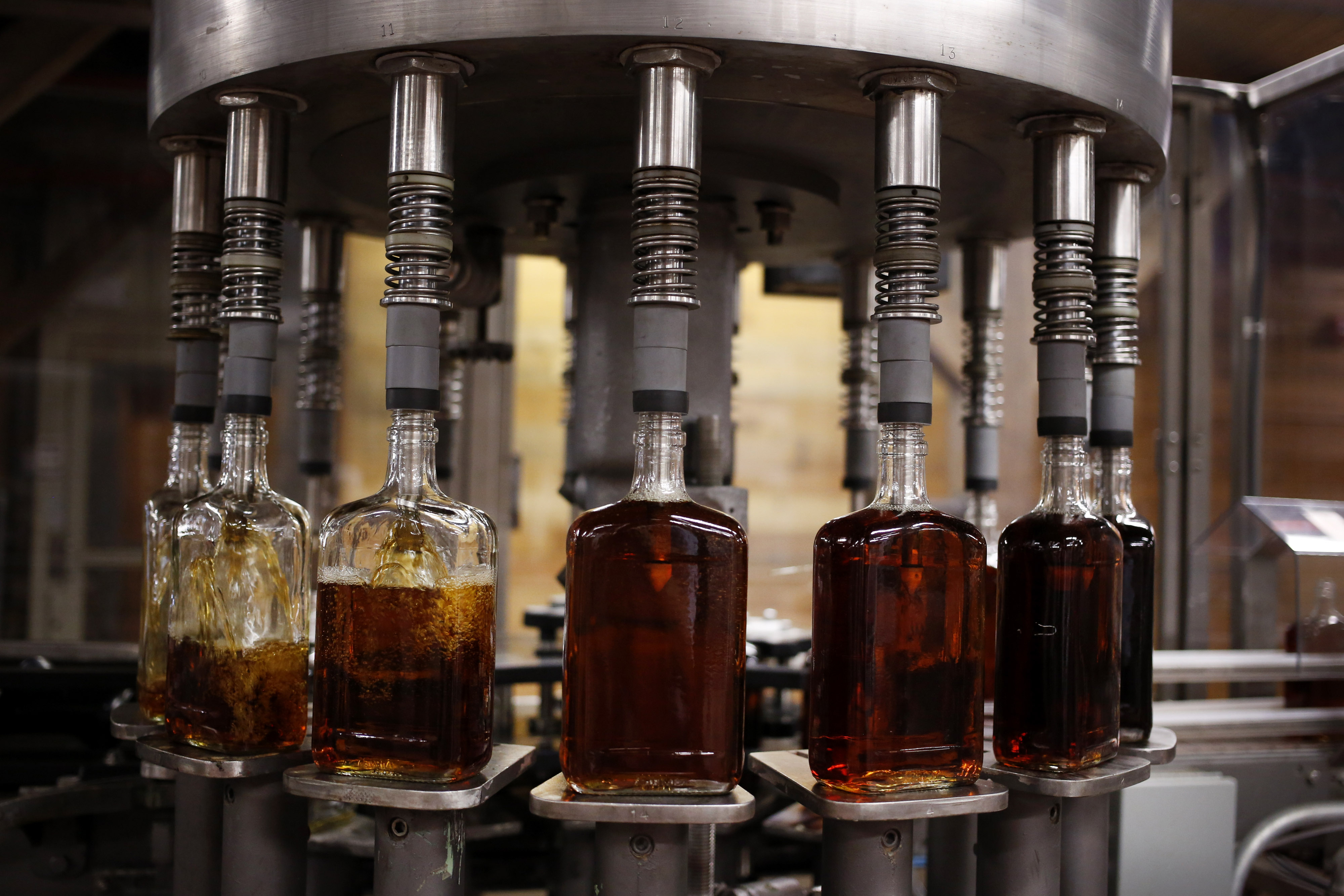 Bottles of single barrel bourbon are filled on the bottling line at a distillery in Kentucky.