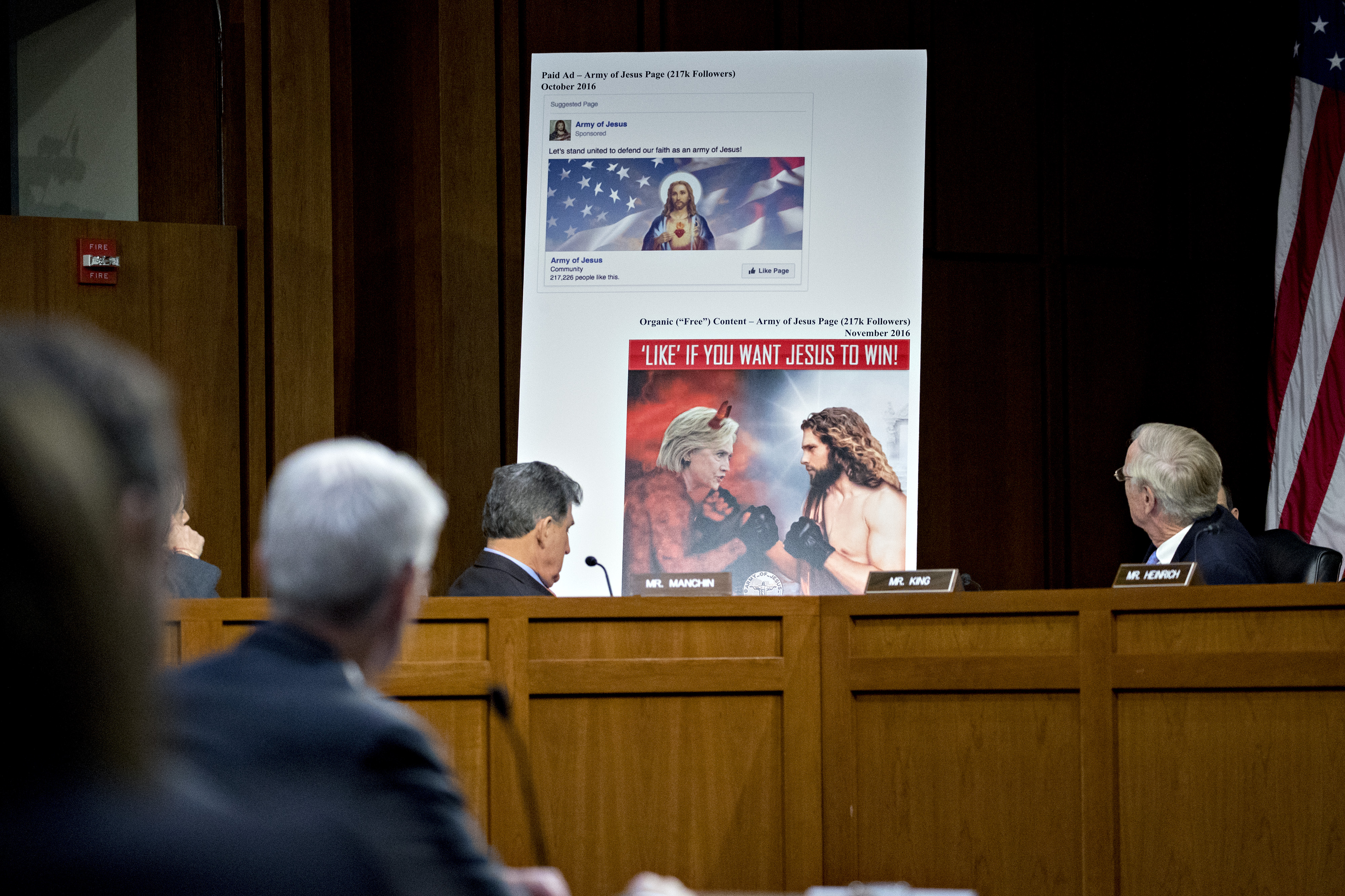 A display showing a social media post stands during a Senate Intelligence Committee hearing on social media influence in the 2016 U.S. elections in Washington, D.C., U.S., on Wednesday,