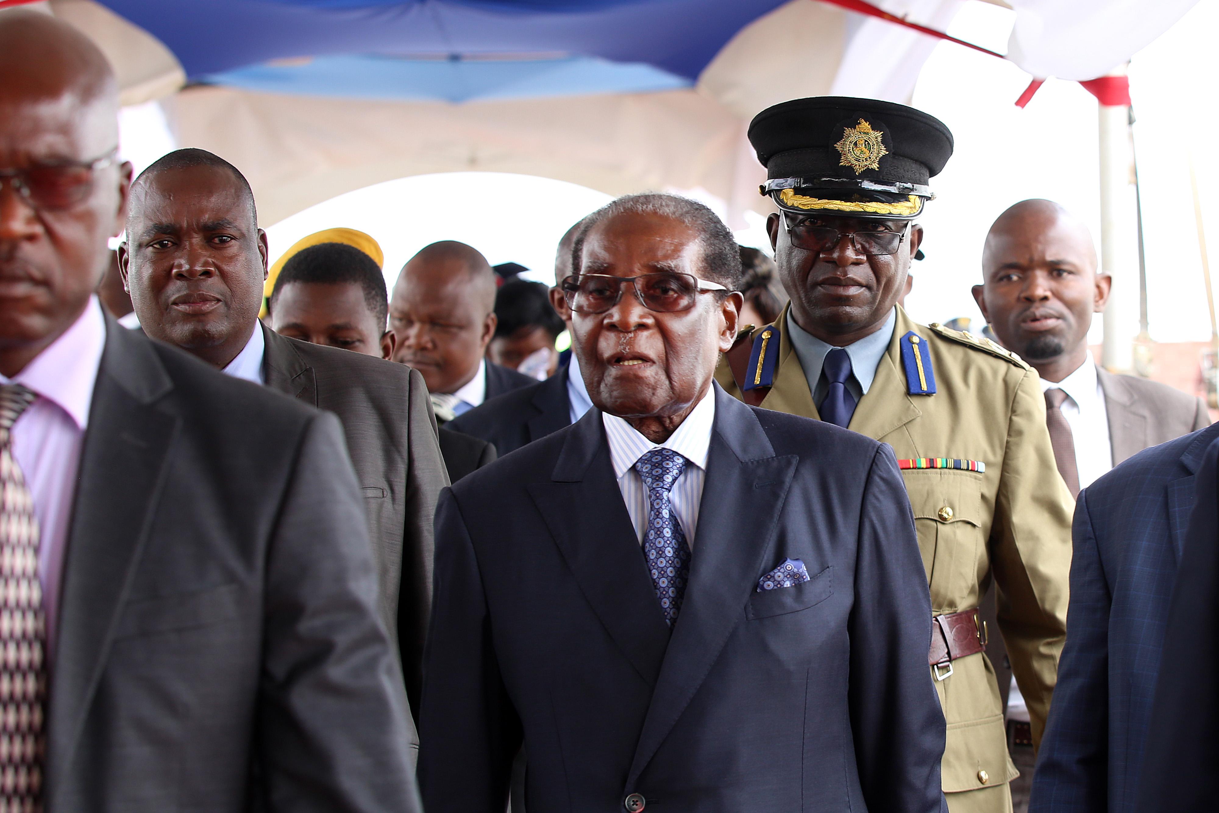 Robert Mugabe, president of Zimbabwe, center, arrives for a student graduation ceremony at Zimbabwe Open University in Harare, Zimbabwe, on Friday, Nov. 17, 2017