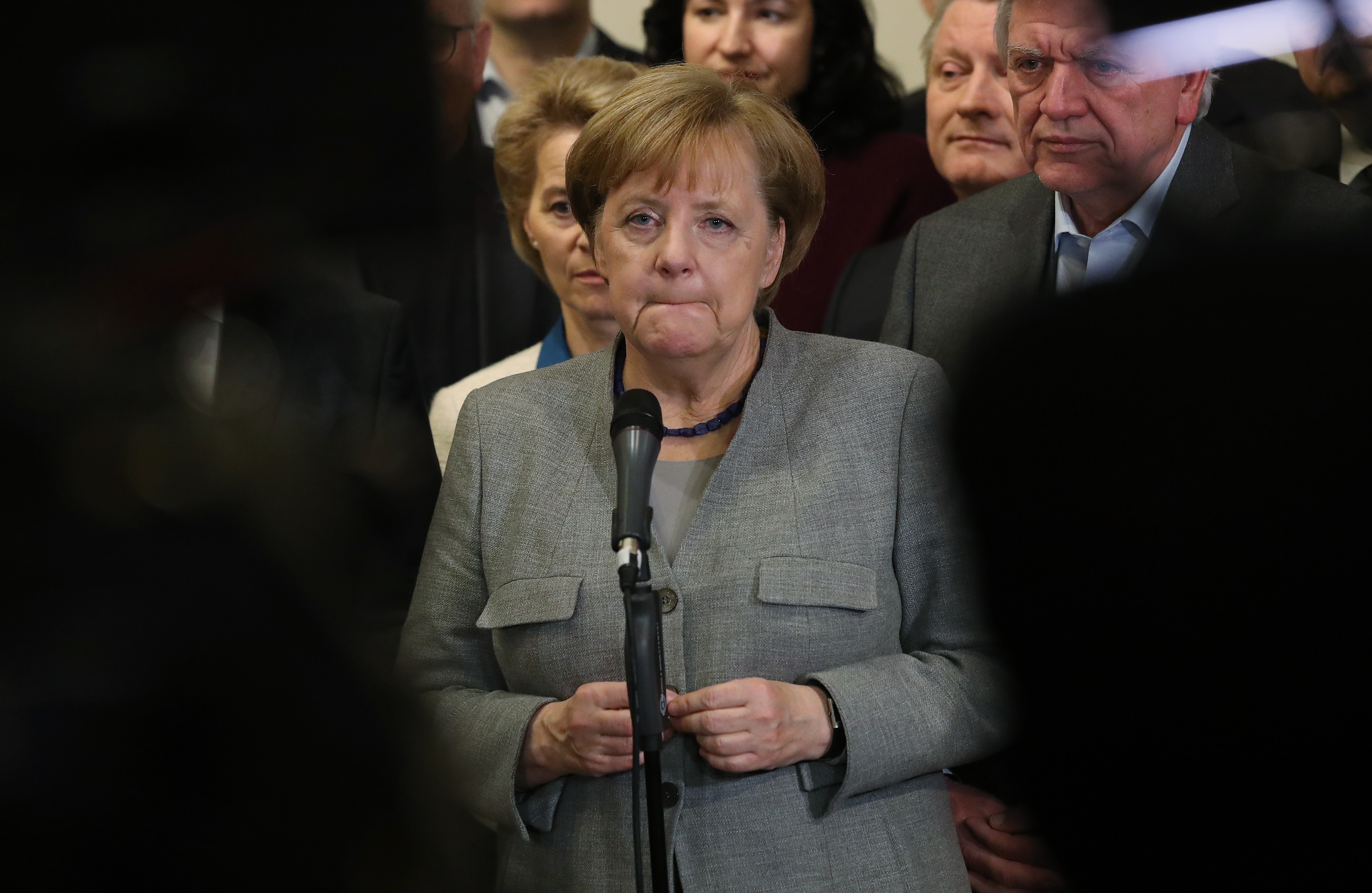 German Chancellor and leader of the German Christian Democrats (CDU) Angela Merkel, standing with leading members of her party, speaks to the media in the early hours after preliminary coalition talks collapsed following                      the withdrawal of the Free Democratic Party (FDP)                      on November 20, 2017 in Berlin, Germany.