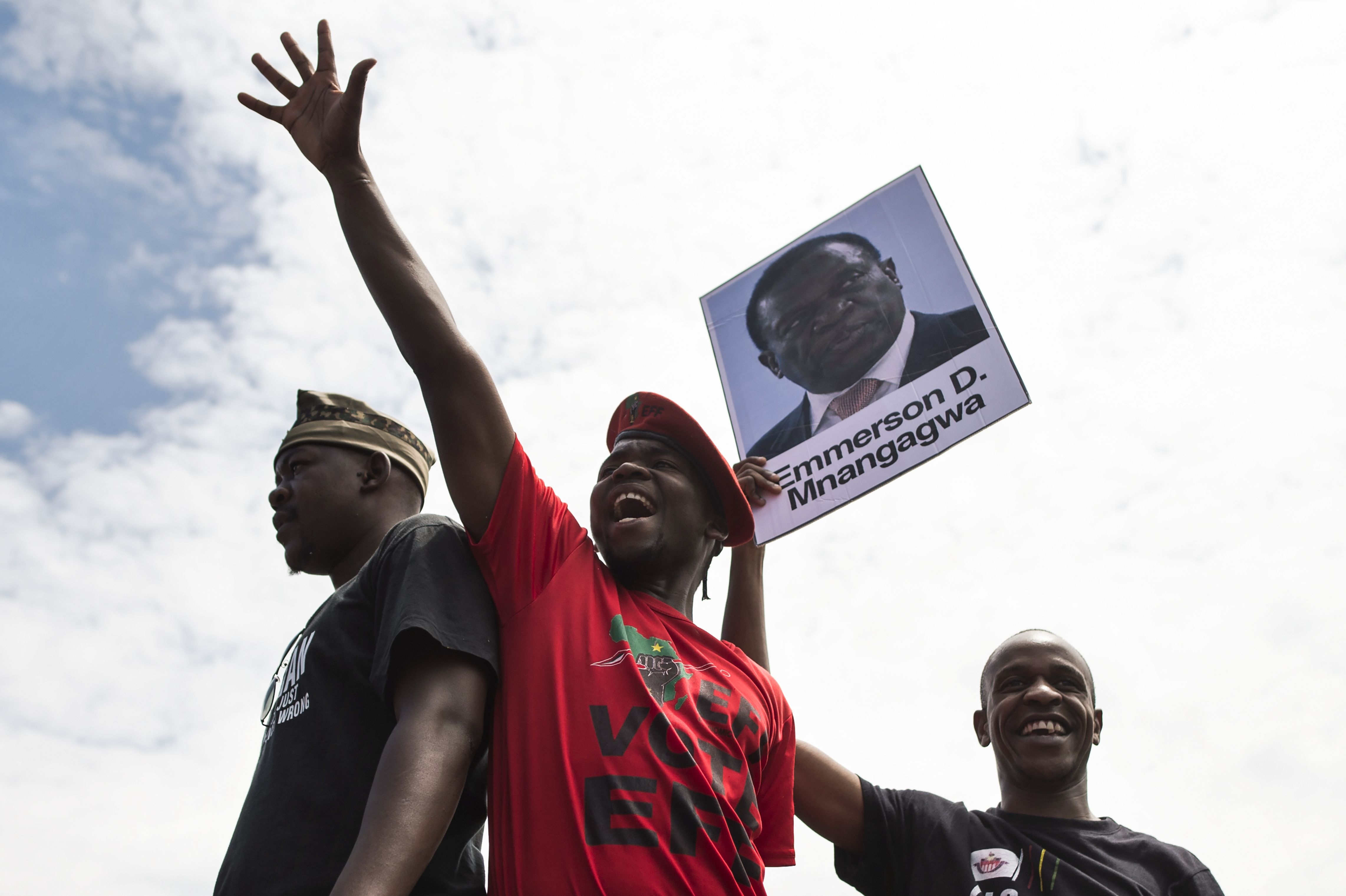 University of Zimbabwe students, holding a portrait of former vice president Emmerson Mnangagwa, take part in a demonstration on Nov. 20, 2017 in Harare, to demand the withdrawal of Grace Mugabe's doctorate