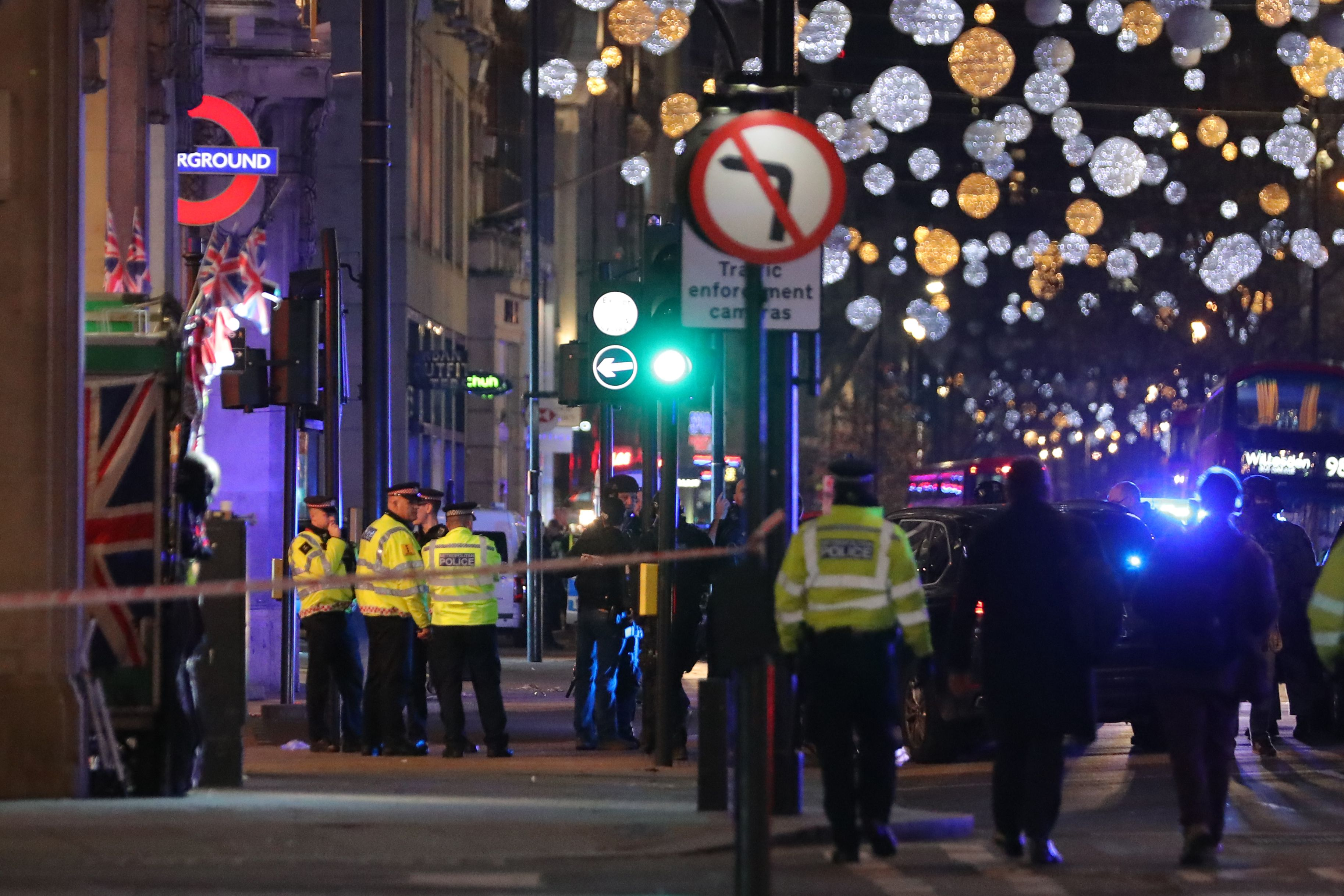 Police set up a cordon outside Oxford Circus underground station as they respond to an incident in central London on November 24, 2017.