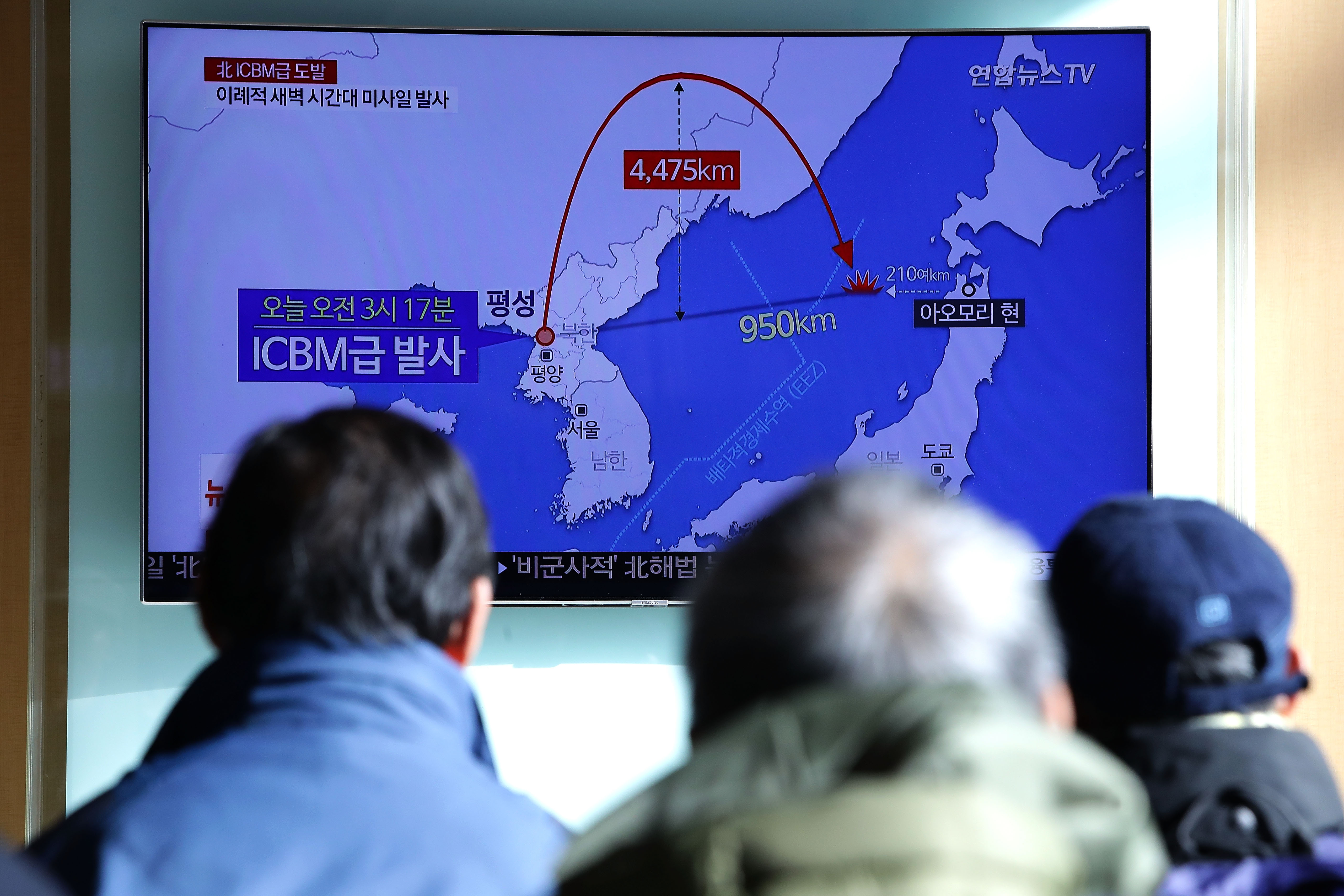 NOV. 29:  People at the Seoul Railway Station in Seoul, South Korea, watch a television broadcast reporting North Korea's Tuesday test-launch of its new ICBM