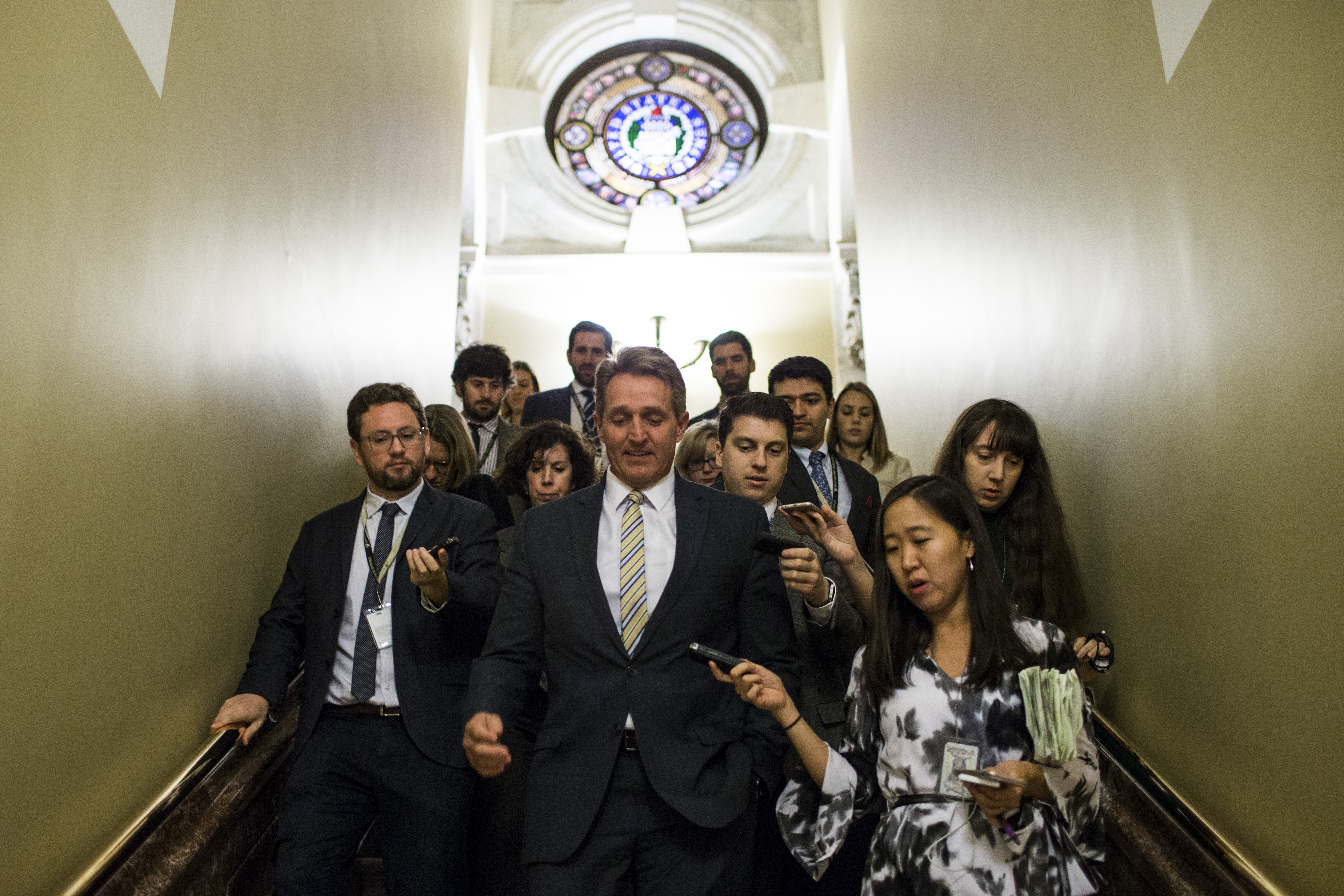 Senator Jeff Flake (R-AZ) speaks to reporters as he leaves a meeting with Senate Republicans on Capitol Hill November 29, 2017 in Washington, DC.
