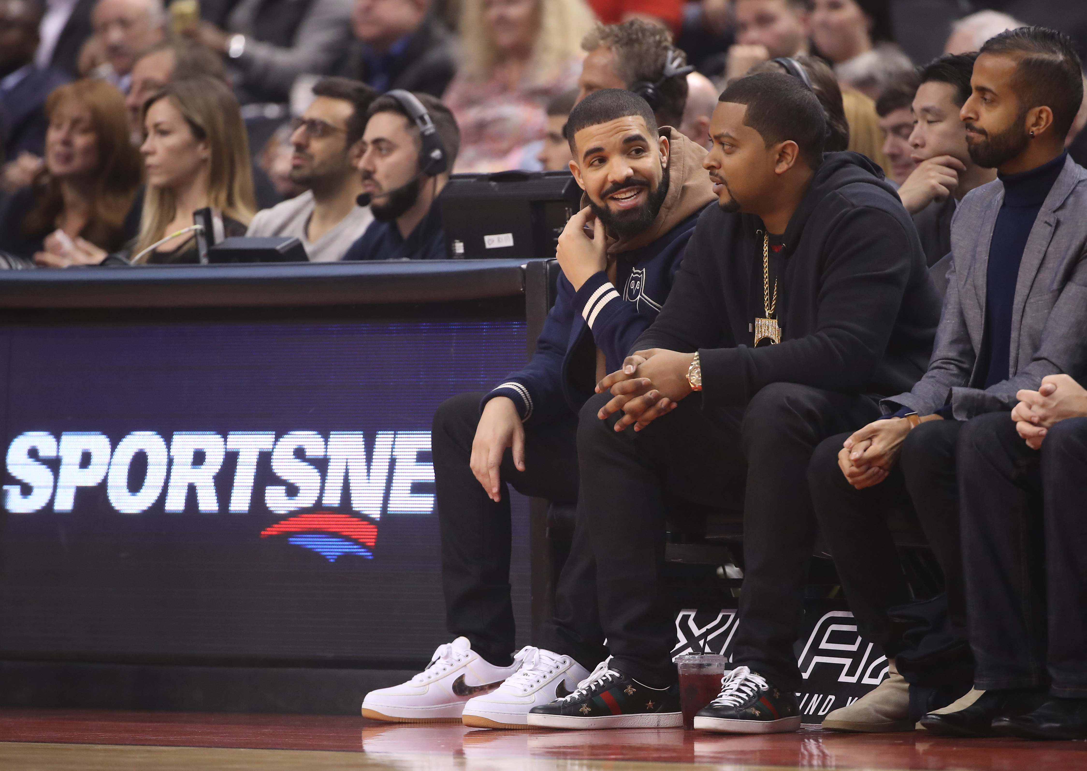TORONTO, ON - NOVEMBER 29: Rap artist and team ambassador Drake of the Toronto Raptors watches from his courtside seat against the Charlotte Hornets during NBA game action at Air Canada Centre on November 29, 2017 in Toronto, Canada. NOTE TO USER: User expressly acknowledges and agrees that, by downloading and or using this photograph, User is consenting to the terms and conditions of the Getty Images License Agreement. (Photo by Tom Szczerbowski/Getty Images)