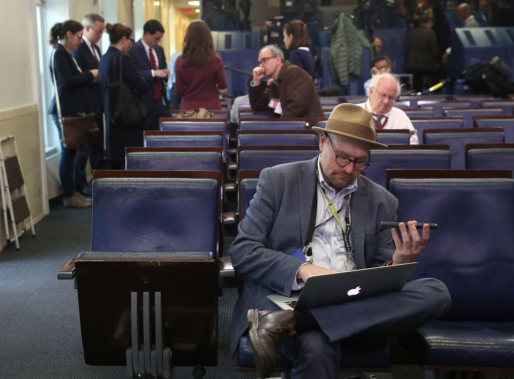 New York Times reporter Glenn Thrush works in the Brady Briefing Room after being excluded from a press gaggle by White House Press Secretary Sean Spicer, in Washington, DC, on Feb. 24, 2017.