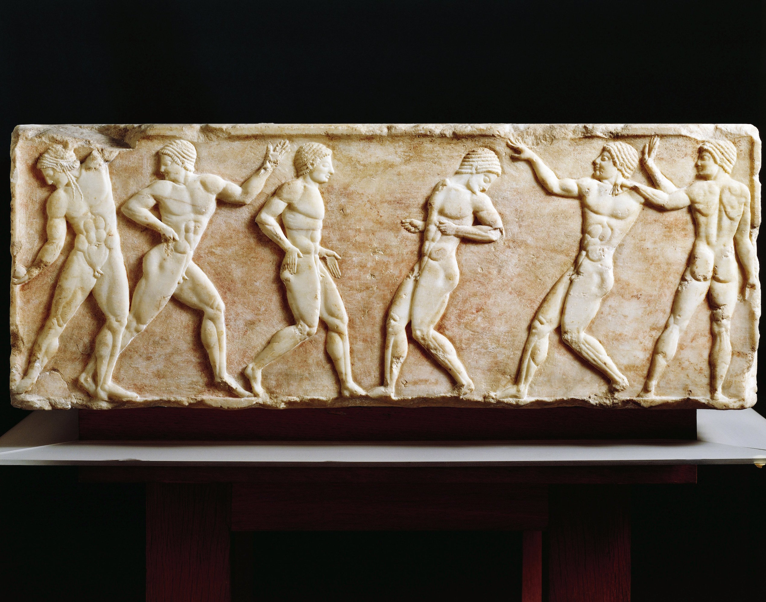 6th century BC stele depicting athletes at the gymnasium, from the Kerameikos necropolis in Athens.
