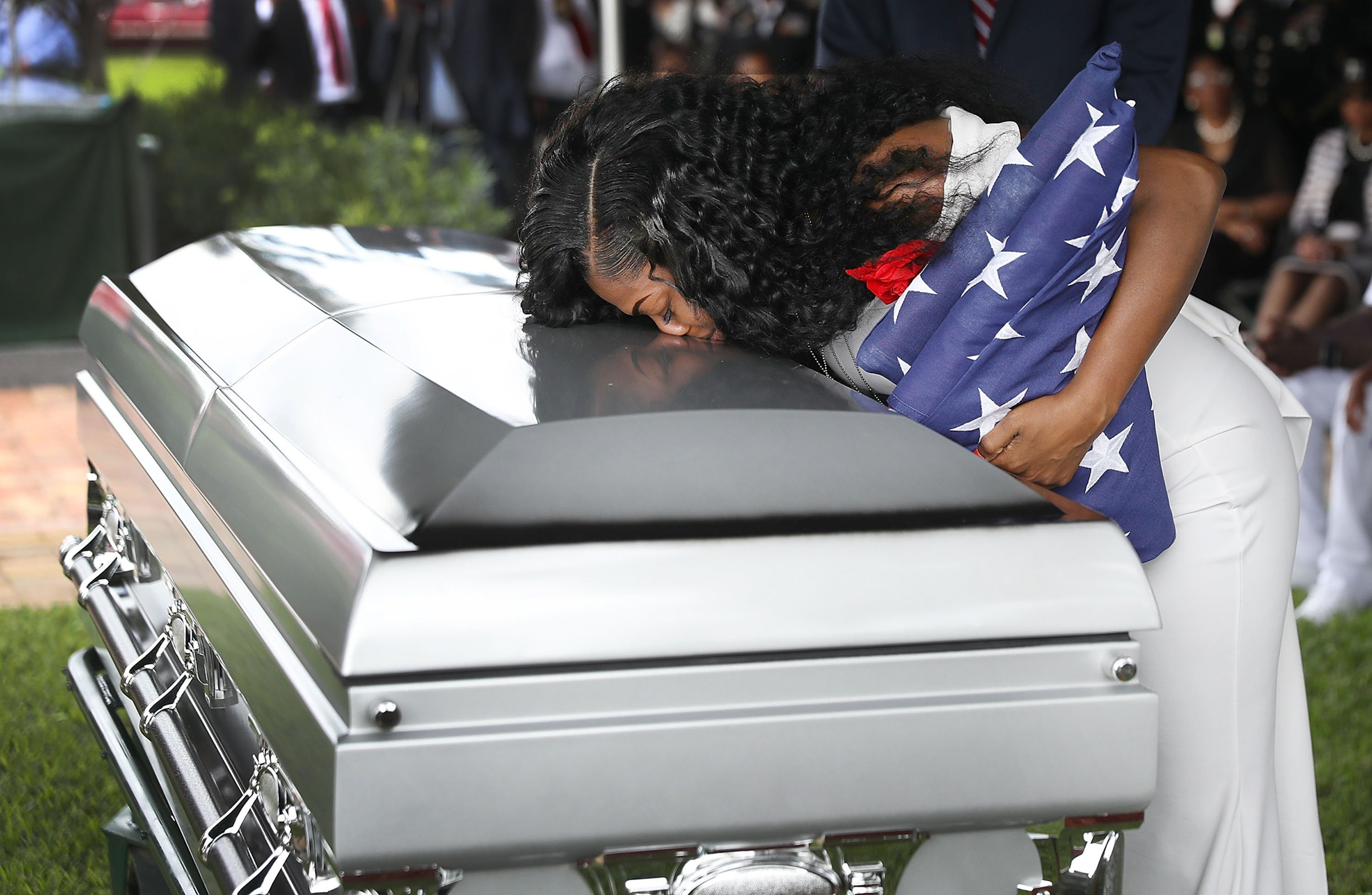 Myeshia Johnson kisses the casket of her husband, Sergeant La David Johnson, who was killed on Oct. 4 in Niger