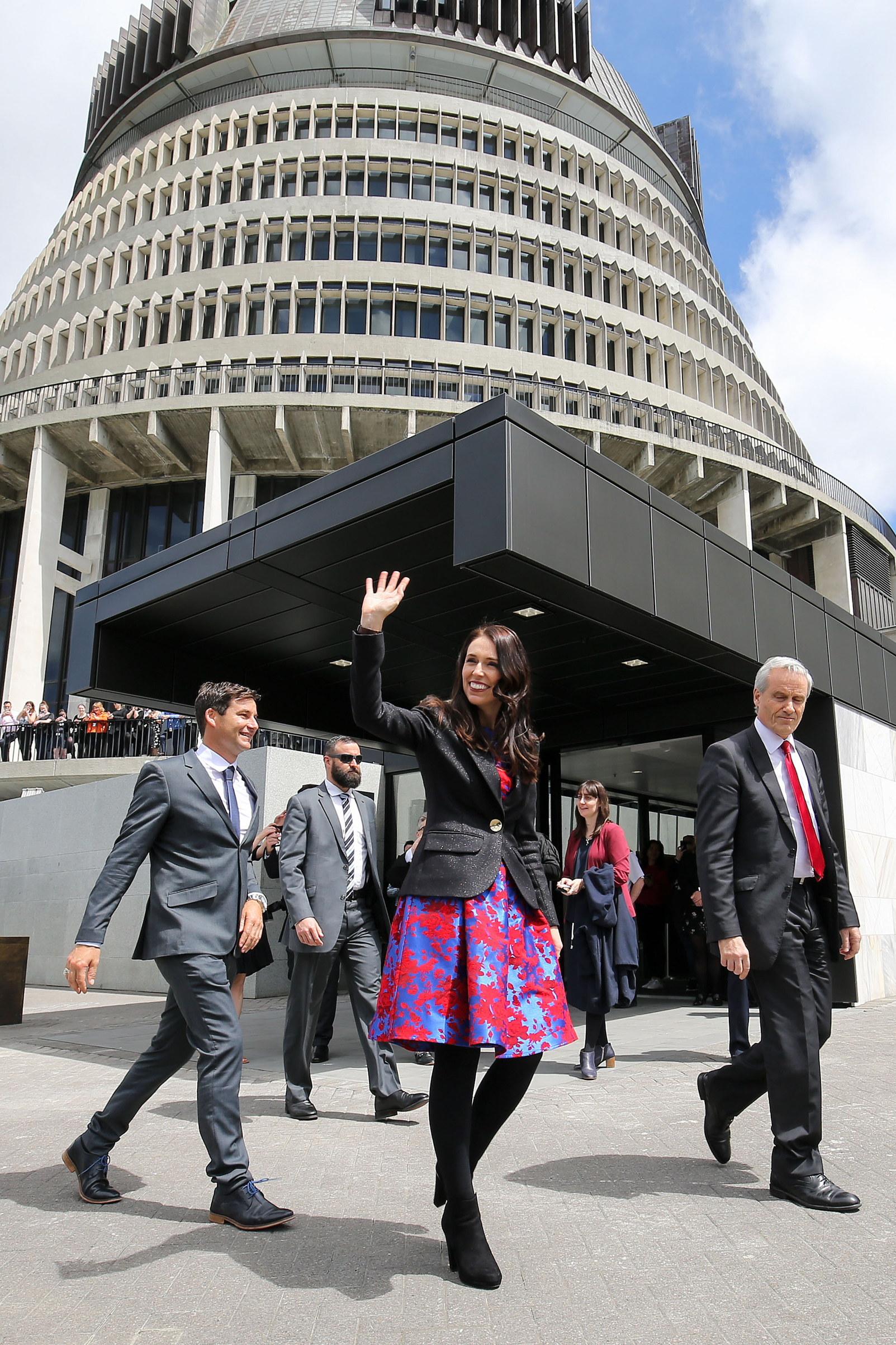 Prime Minister Jacinda Ardern and partner Clarke Gayford arrive at Parliament after a swearing-in ceremony at Government House in Wellington on Oct. 26, 2017.