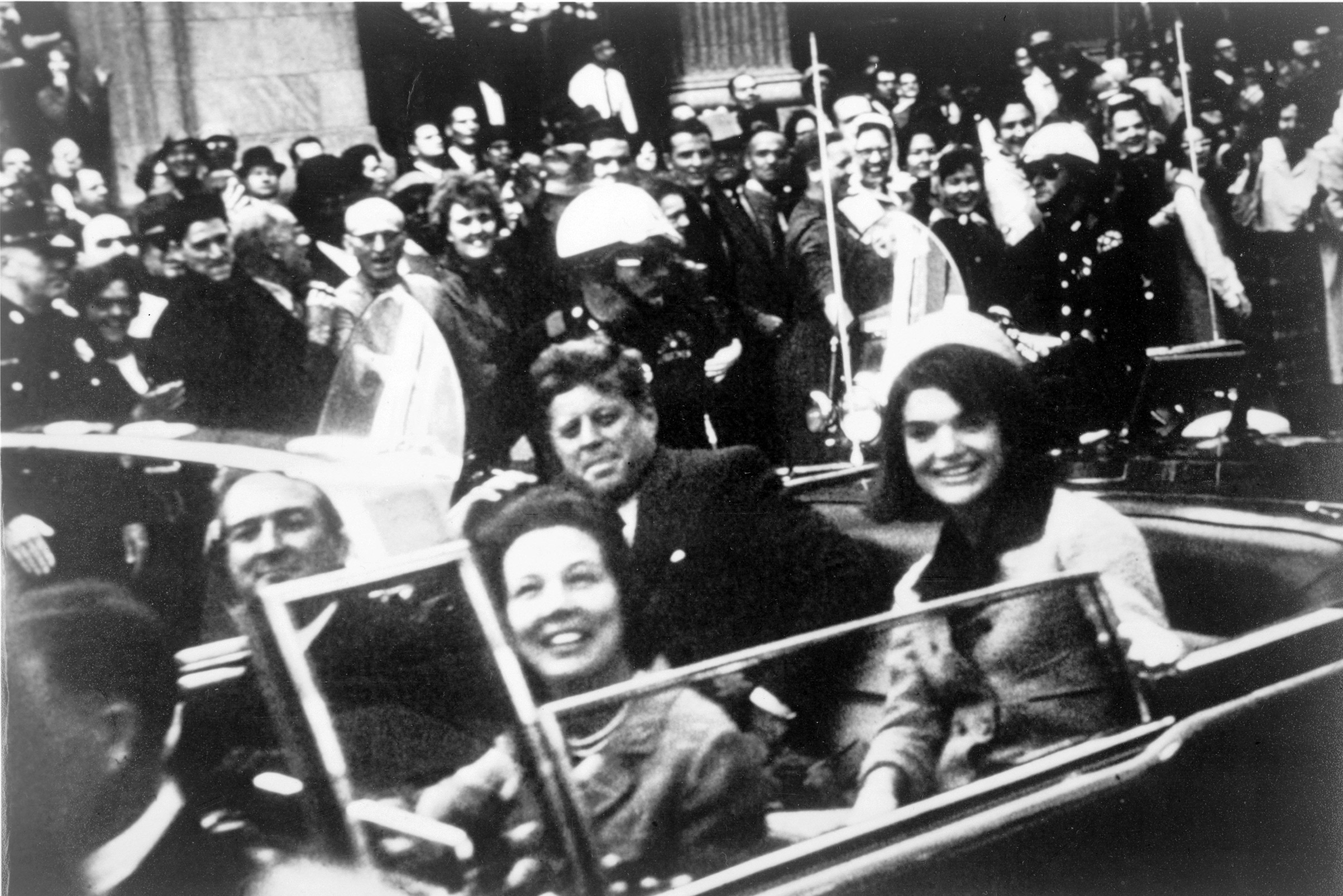 President John F. Kennedy and First Lady Jackie Onasis Kennedy in motorcade with  Texas Governor John Connally and his wife in motorcade on Nov. 22, 1963, in Dallas.