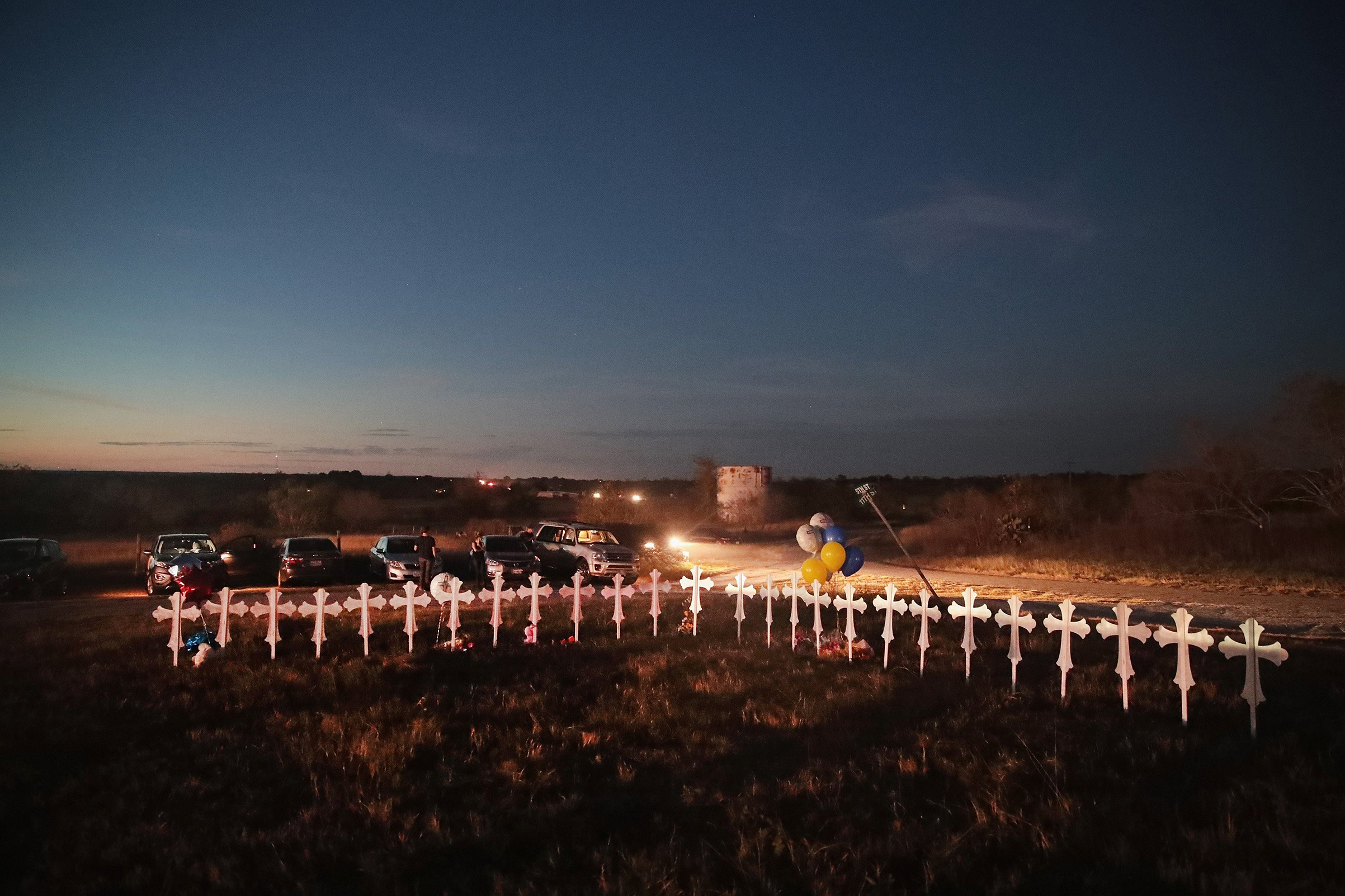 Twenty-six crosses, one for each of the dead, stand in a field on the edge of town on Nov. 6