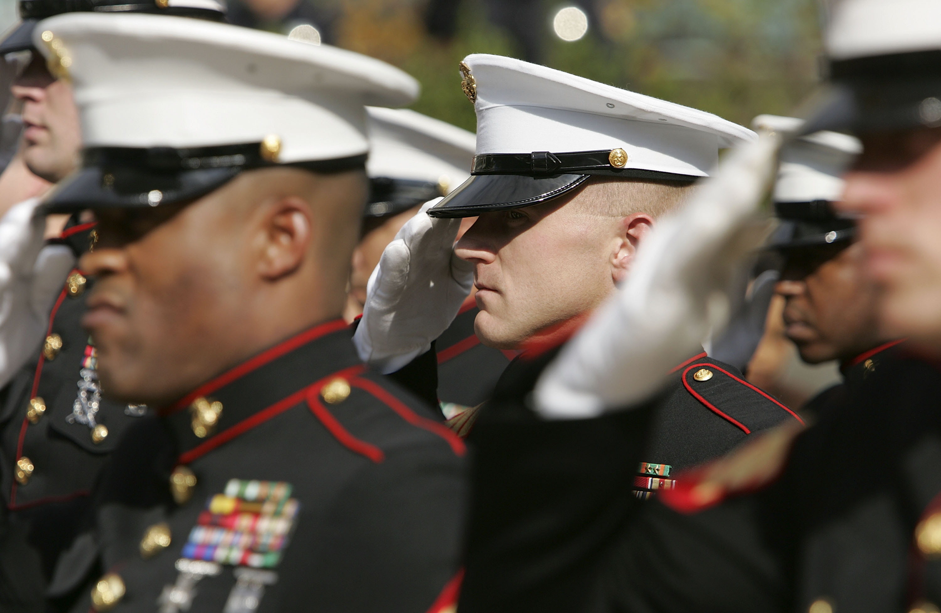 SAN FRANCISCO - NOVEMBER 10:  Members of the U.S. Marine Corp honor guard salute during the singing of the National Anthem during the unveiling ceremony for the new  Distinguished Marines  commemorative stamps November 10, 2005 in San Francisco, California. The U.S. Postal Service issued a commemorative stamp series called  Distinguished Marines.  on the 230th birthday of the U.S. Marine Corp. The four-stamp series features images of U.S. Marines Lewis B. Puller, Daniel J. Daly, John Basilone and John A. Lejeune.  (Photo by Justin Sullivan/Getty Images)