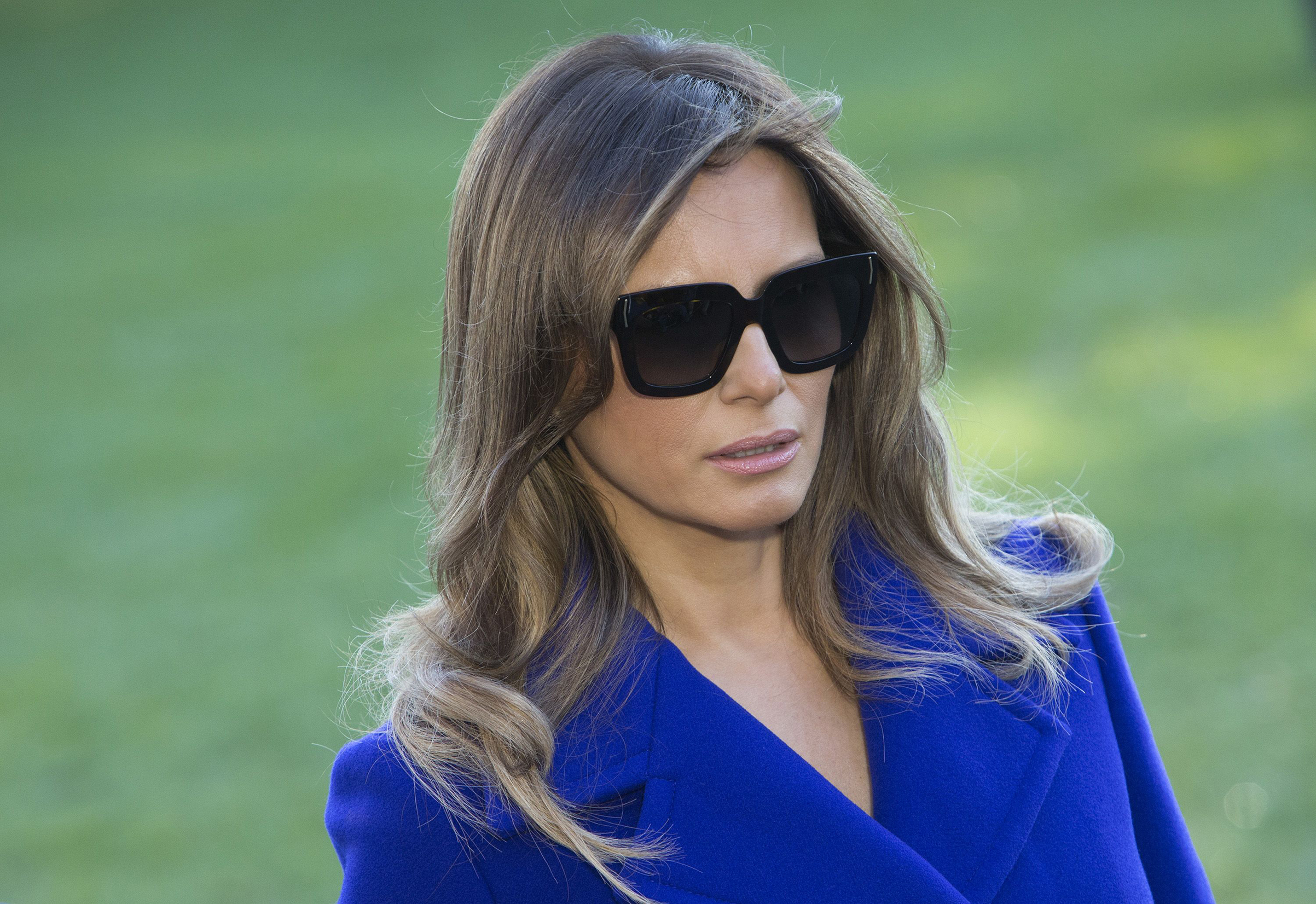 First lady Melania Trump listens as United States President Donald J. Trump speaks to the media before departing the White House in Washington, on Nov. 3, 2017.