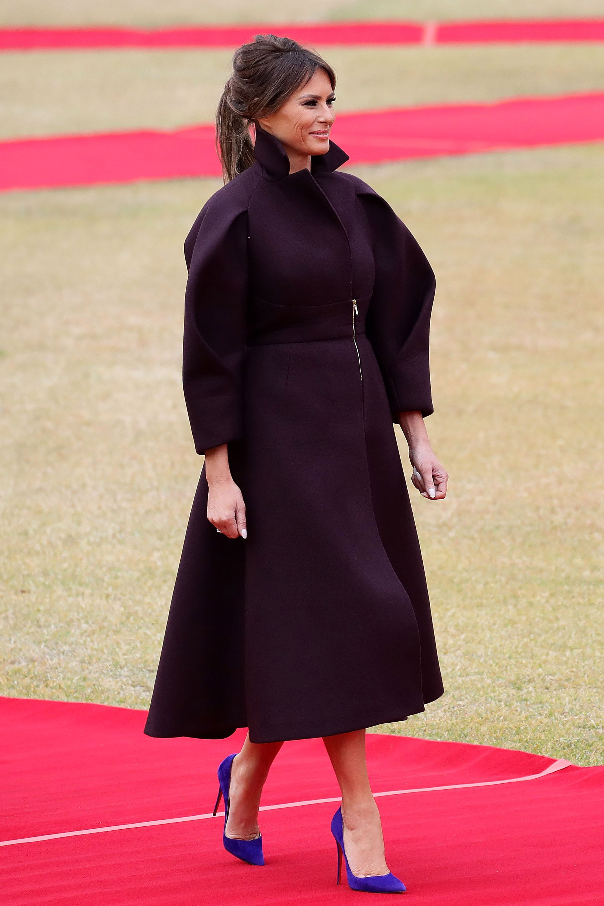 First Lady Melania Trump wears a sculptural mauve coatdress with an exposed zipper by Delpozo during a welcoming ceremony held at the presidential Blue House in Seoul, South Korea, on Nov. 7, 2017.