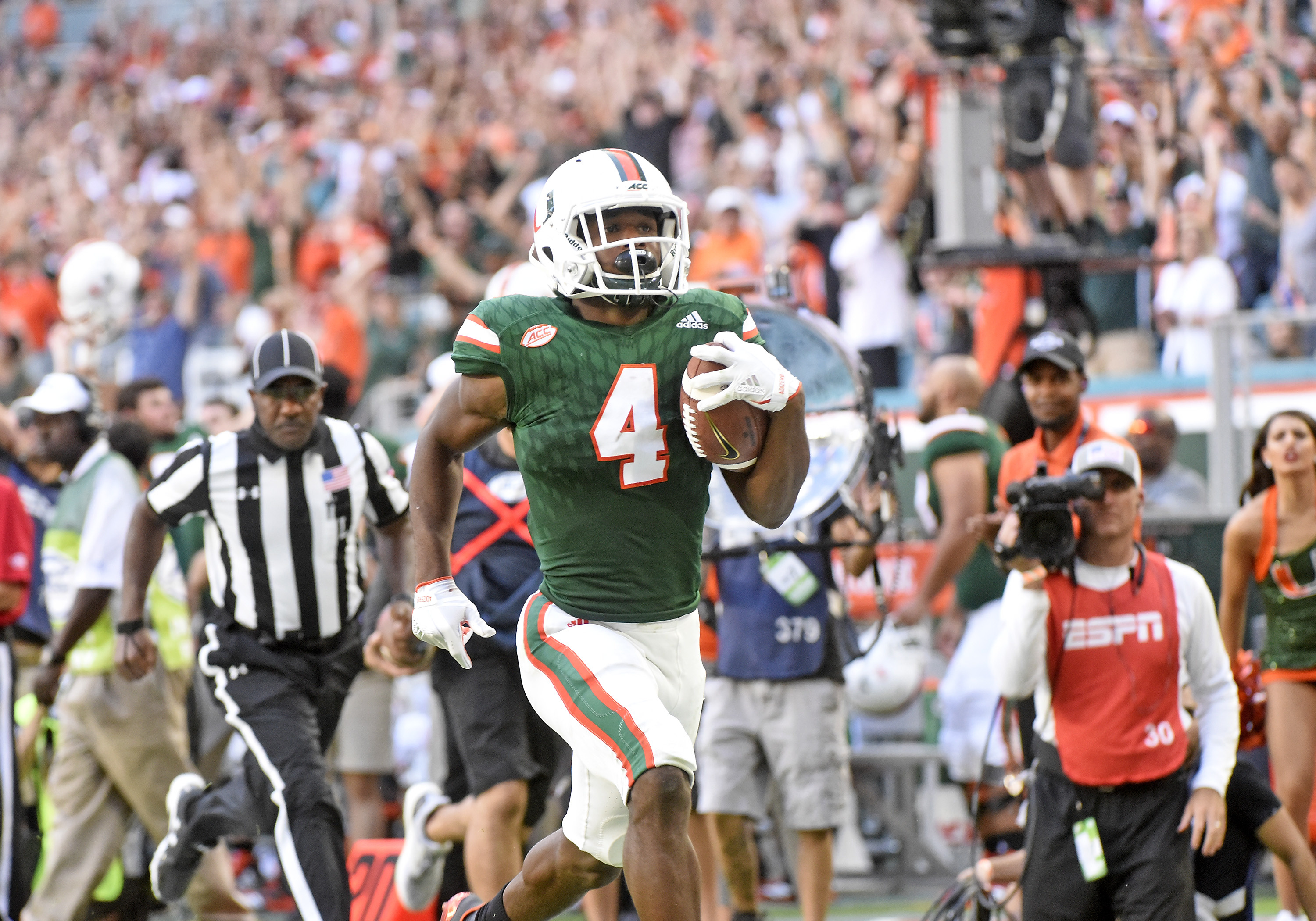 University of Miami defensive back Jaquan Johnson returns an interception for a score during a game against the University of Virginia on Nov. 18, 2017 at Hard Rock Stadium, in Miami