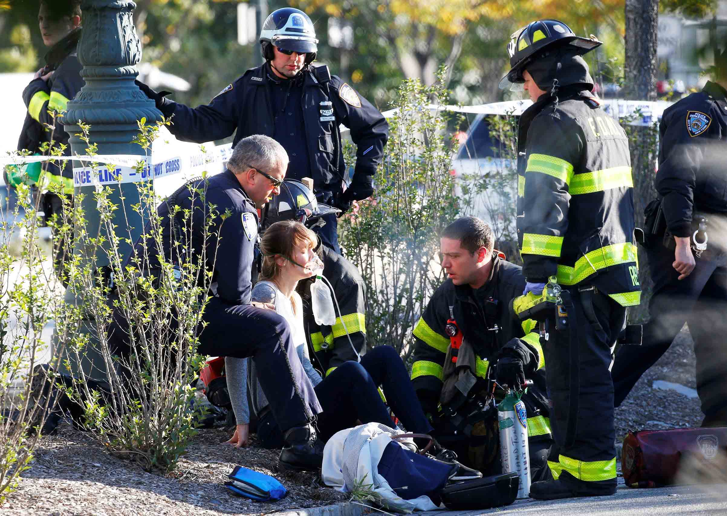 An injured woman is given oxygen by first responders after the terrorist attack that killed eight people along the West Side Highway in Lower Manhattan on Oct. 31