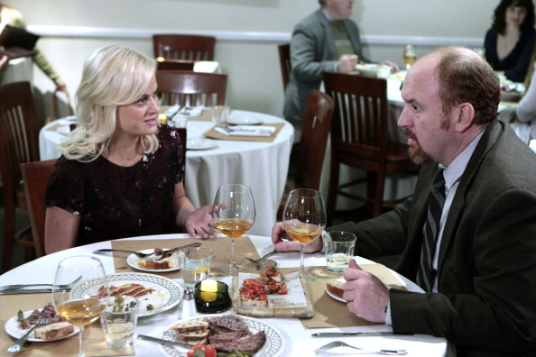 Amy Poehler as Leslie Knope and Louis C.K. as Dave Sanderson in Parks and Recreation