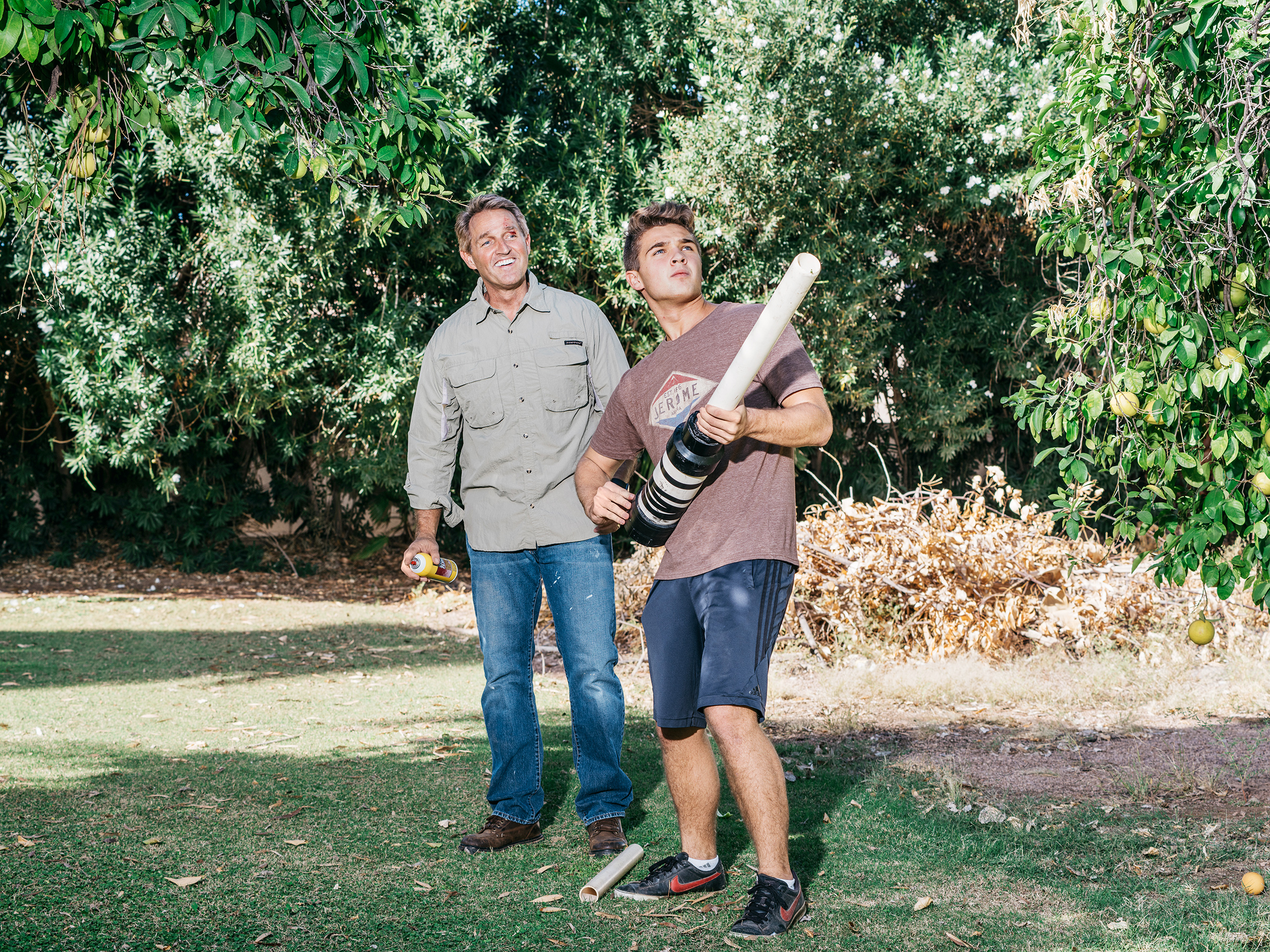 The senator and his son Dallin play with a homemade grapefruit cannon in the family's Arizona backyard.