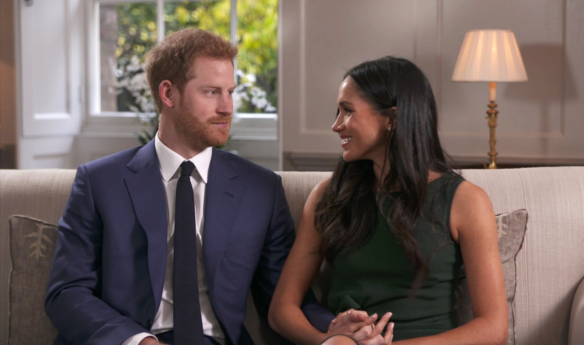 In this photo taken from video Britain's Prince Harry and Meghan Markle talk about their engagement during an interview in London on Nov. 27, 2017.
