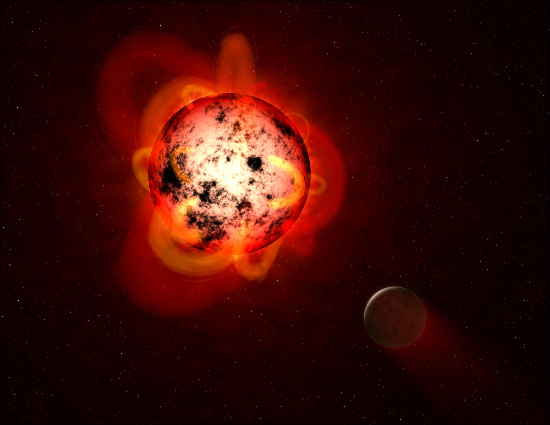 Hot but cold: A red dwarf is cool by stellar standards, but a flare                      — pictured here in an artist's rendering —                      could do bad things to a nearby planet.