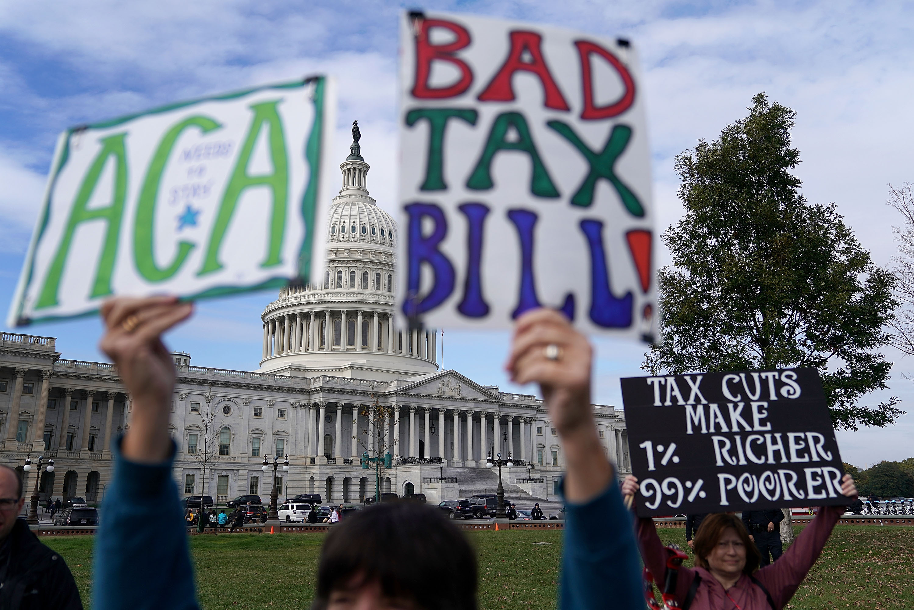 Demonstrators join a rally against the proposed Republican tax reform legislation on the east side of the U.S. Capitol on Nov. 15, 2017 in Washington, D.C.