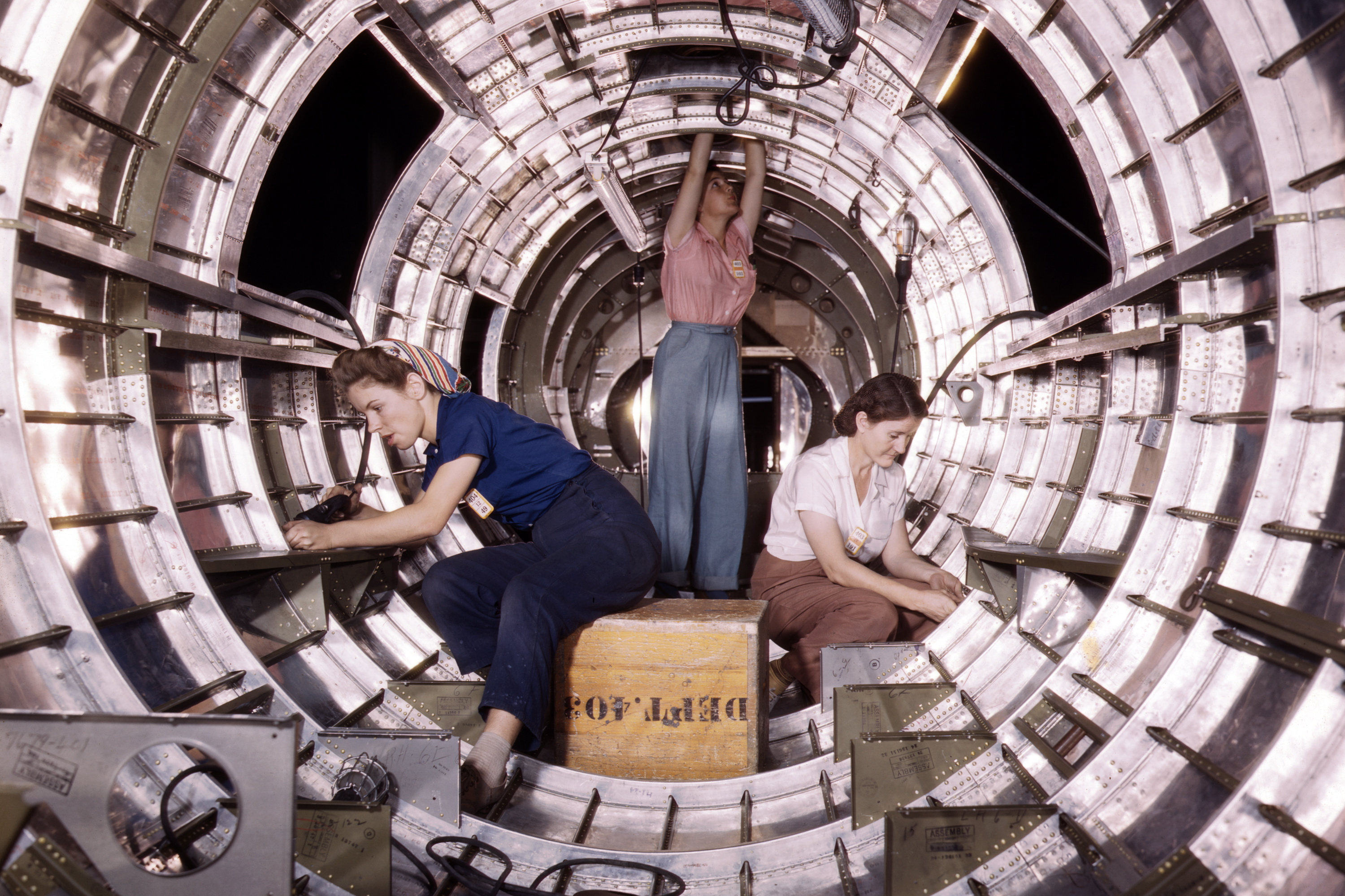 Women workers install fixtures and assemblies to a tail fuselage section of a B-17 bomber at the Douglas Aircraft Company plant, Long Beach, Calif. Better known as the  Flying Fortress,  the B-17F is a later model of the B-17, which distinguished itself in action in the south Pacific, Germany and elsewhere.